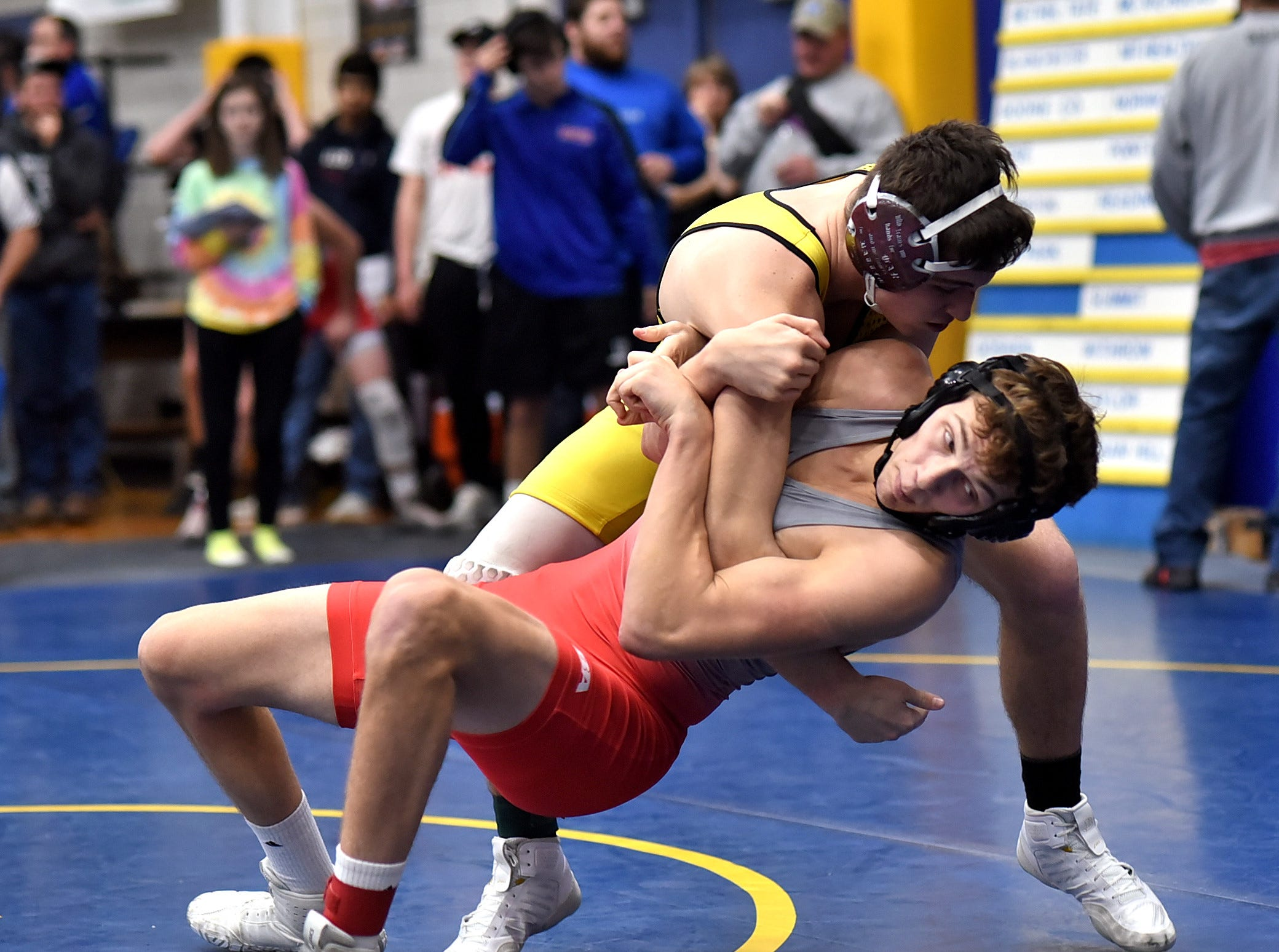 Dakotah Rider of Taylor  takes Chad Davis of Goshen to the mat in the 170 lbs. class at the Bob Kearns Madeira Invitational, January 4, 2019.