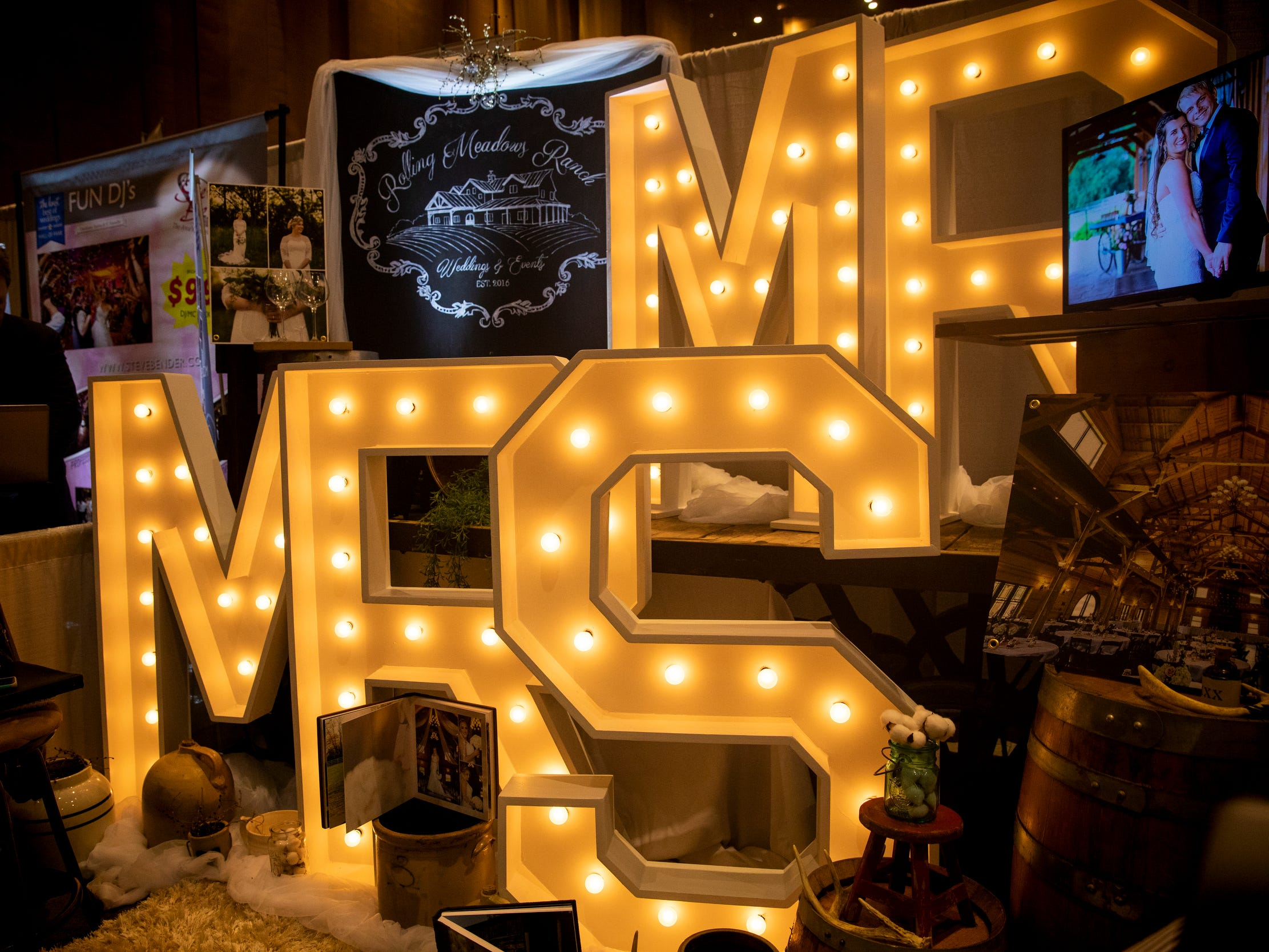 """Rolling Meadows Ranch is a wedding event center in Lebanon. Their booth at Wendy's Bridal Show featured large lit """"Mr"""" and """"Mrs"""" signs at the Duke Energy Convention Center Saturday, January 5, 2019 in Downtown Cincinnati."""
