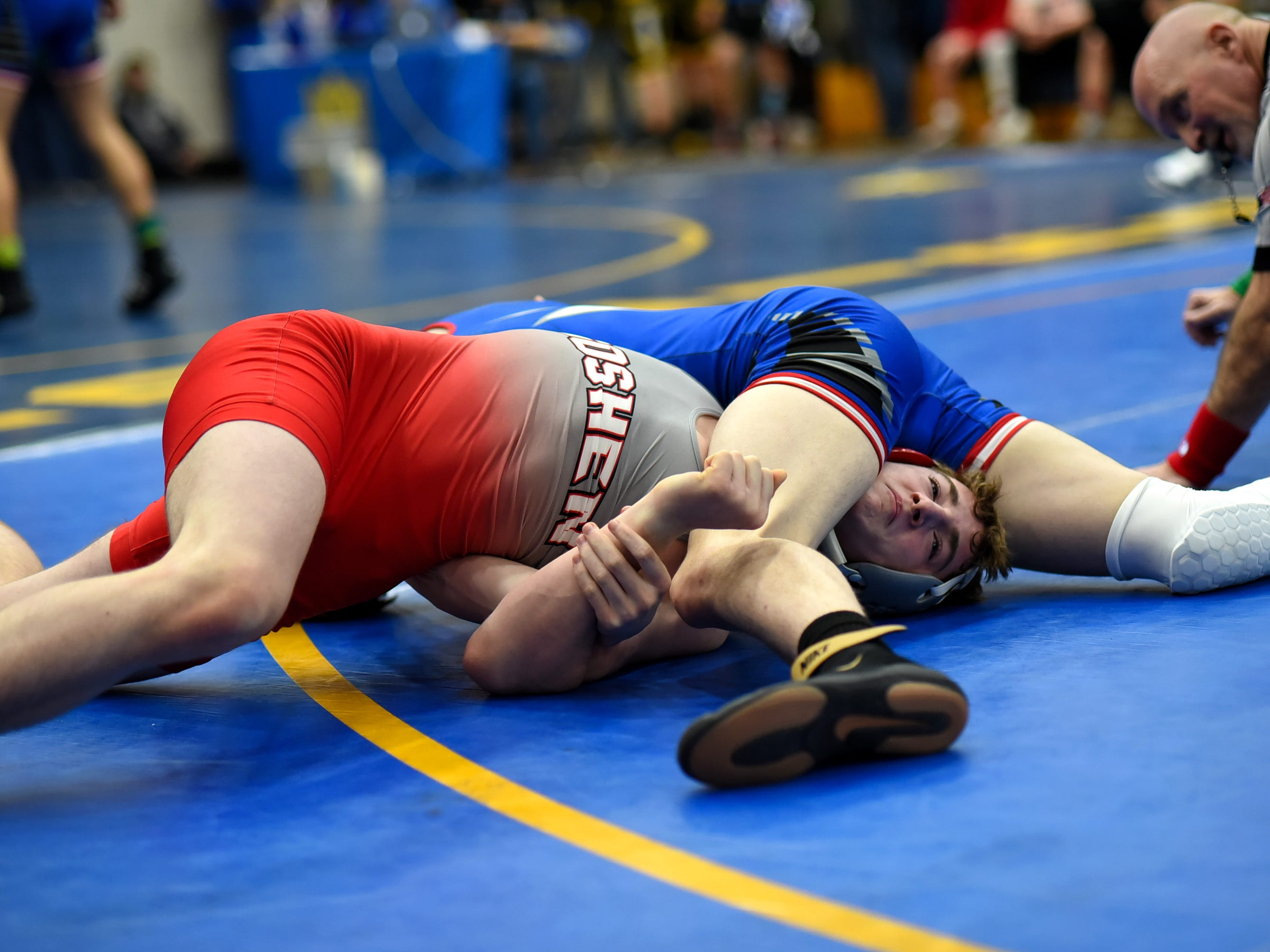 Jon Woodward of Goshen tries to work out of a pinfall jam while wrestling in the 132 lbs. class at the Bob Kearns Madeira Invitational, January 4, 2019.