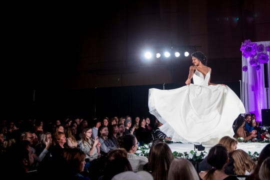 A model twirls in a wedding dress for the fashion show at the Wendy's Bridal Show at the Duke Energy Convention Center Saturday, January 5, 2019 in Downtown Cincinnati.