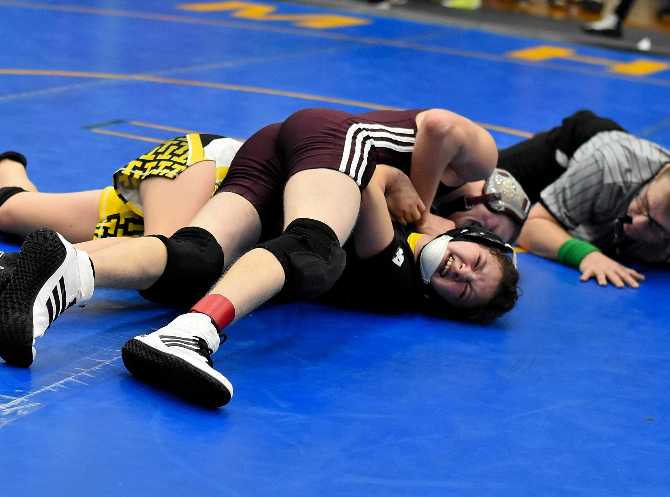 Taylor Schmidt of Hillcrest pins Cerenity Bergeron of Taylor in the first round at the Bob Kearns Madeira Invitational, January 4, 2019.