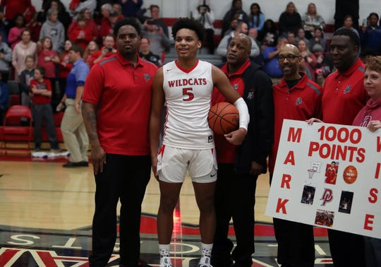 Deer Park guard Mark Wise is recognized after scoring his 1,000th point in the first quarter in the boys basketball game between the Madeira Mustangs and the Deer Park Wildcats at Deer Park High School Jan. 4.