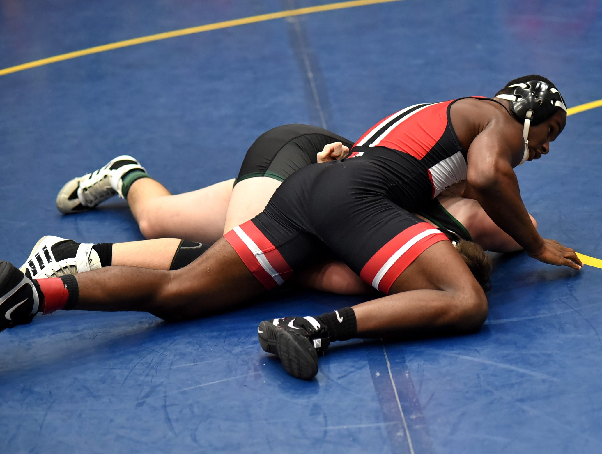 John Mark Williams of Indian Hill takes down Vincent Biser of McNicholas in early action at the Bob Kearns Madeira Invitational, January 4, 2019.