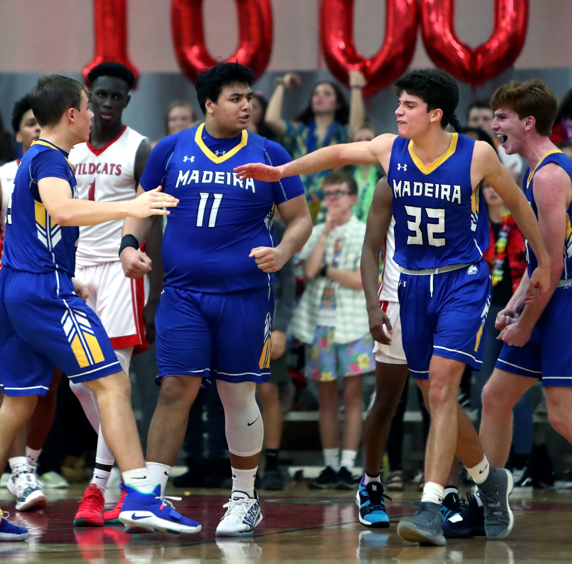 Madeira forward James Lytle is congratulated by...