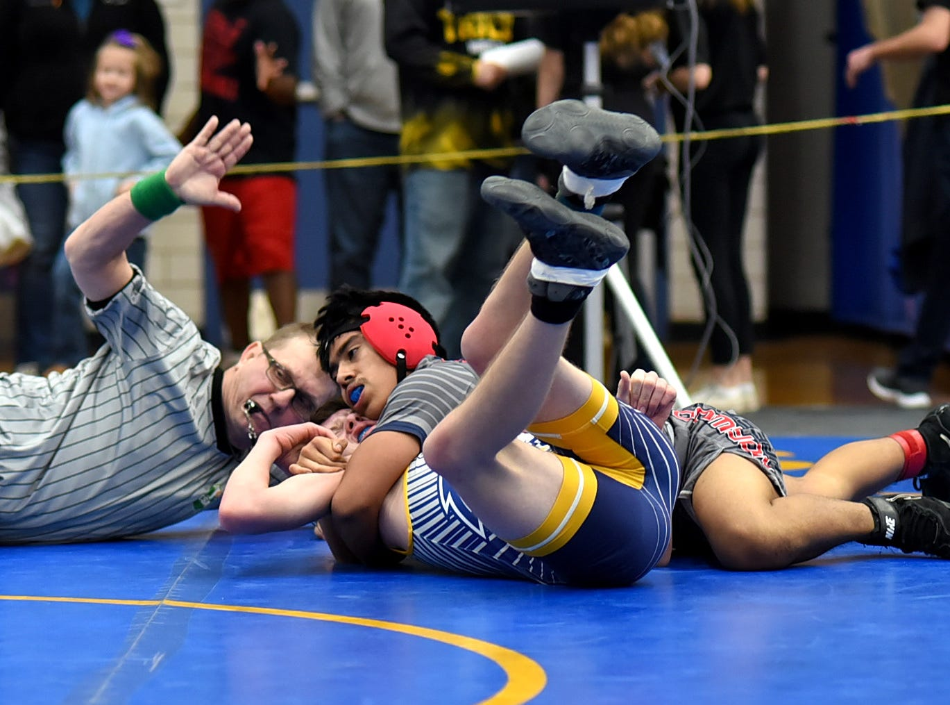 Norwood's Jason Almengor buttons up a pinfall over Madeira's Kobe Jones in the first round of the Bob Kearns Madeira Invitational, January 4, 2019.
