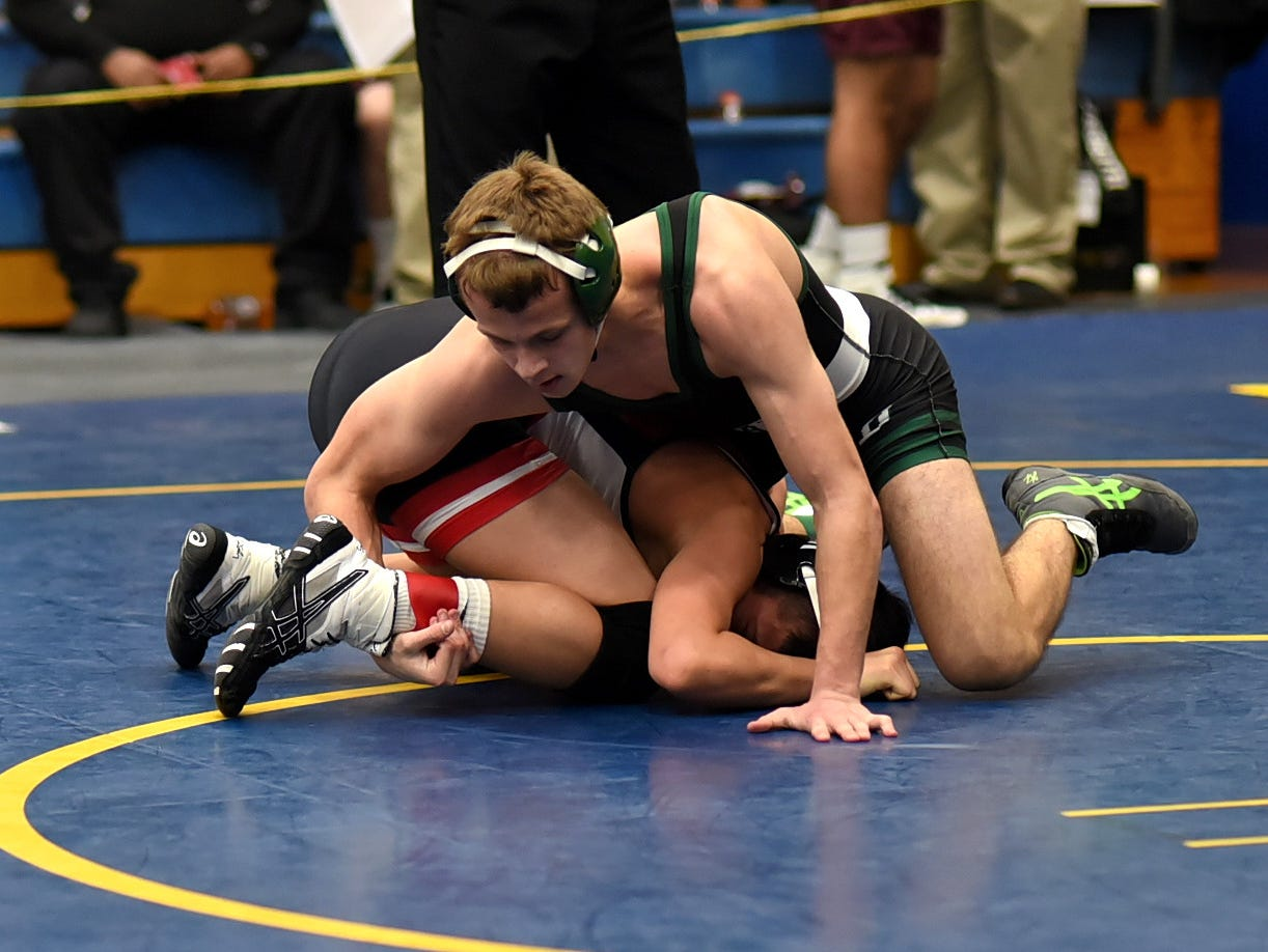 Bryan Sauter of Batavia gains the upper hand on Indian Hill's Sean Castro in the 120 lbs. class at the Bob Kearns Madeira Invitational, January 4, 2019.