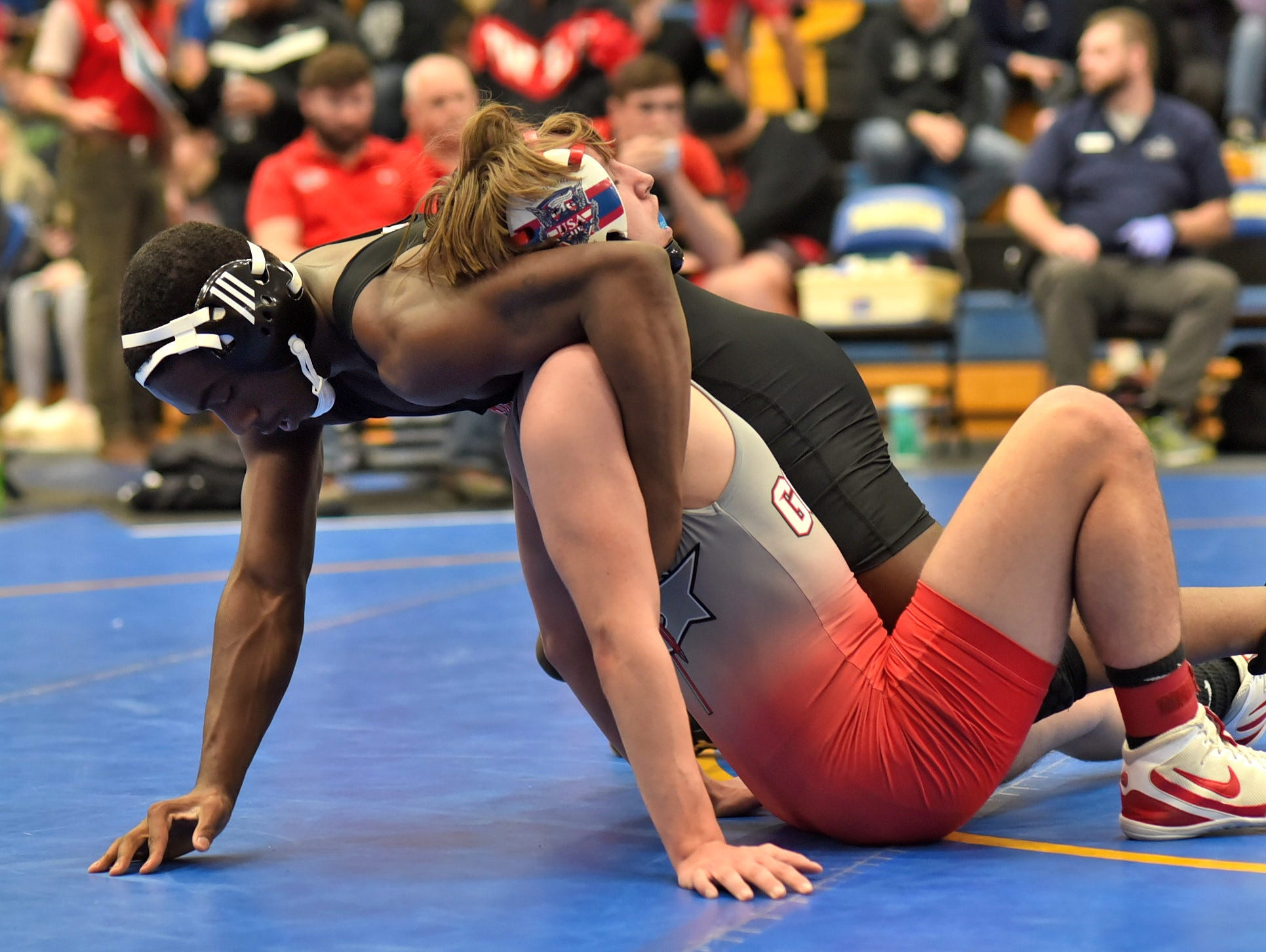 Roman McCauley of Withrow takes down Dale King of Goshen for a first round pinfall in the 160 lbs. class at the Bob Kearns Madeira Invitational, January 4, 2019.