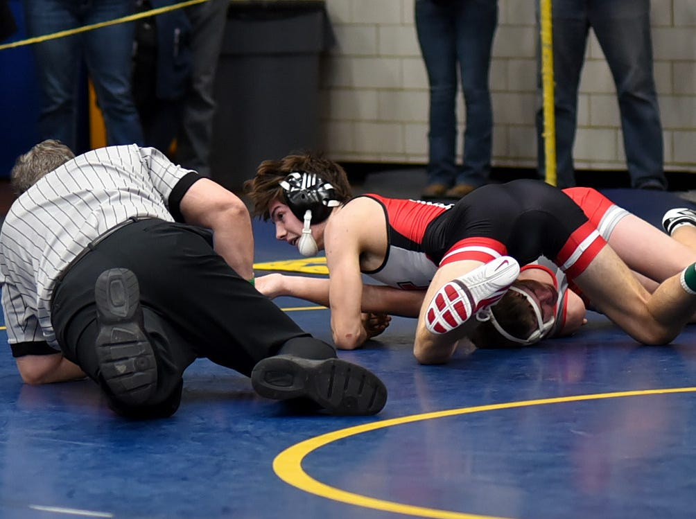 Spencer Magialardo of Indian Hill scores a pin in early action over Bubba Carter of Bethel-Tate in the 126 lbs. class at the Bob Kearns Madeira Invitational, January 4, 2019.