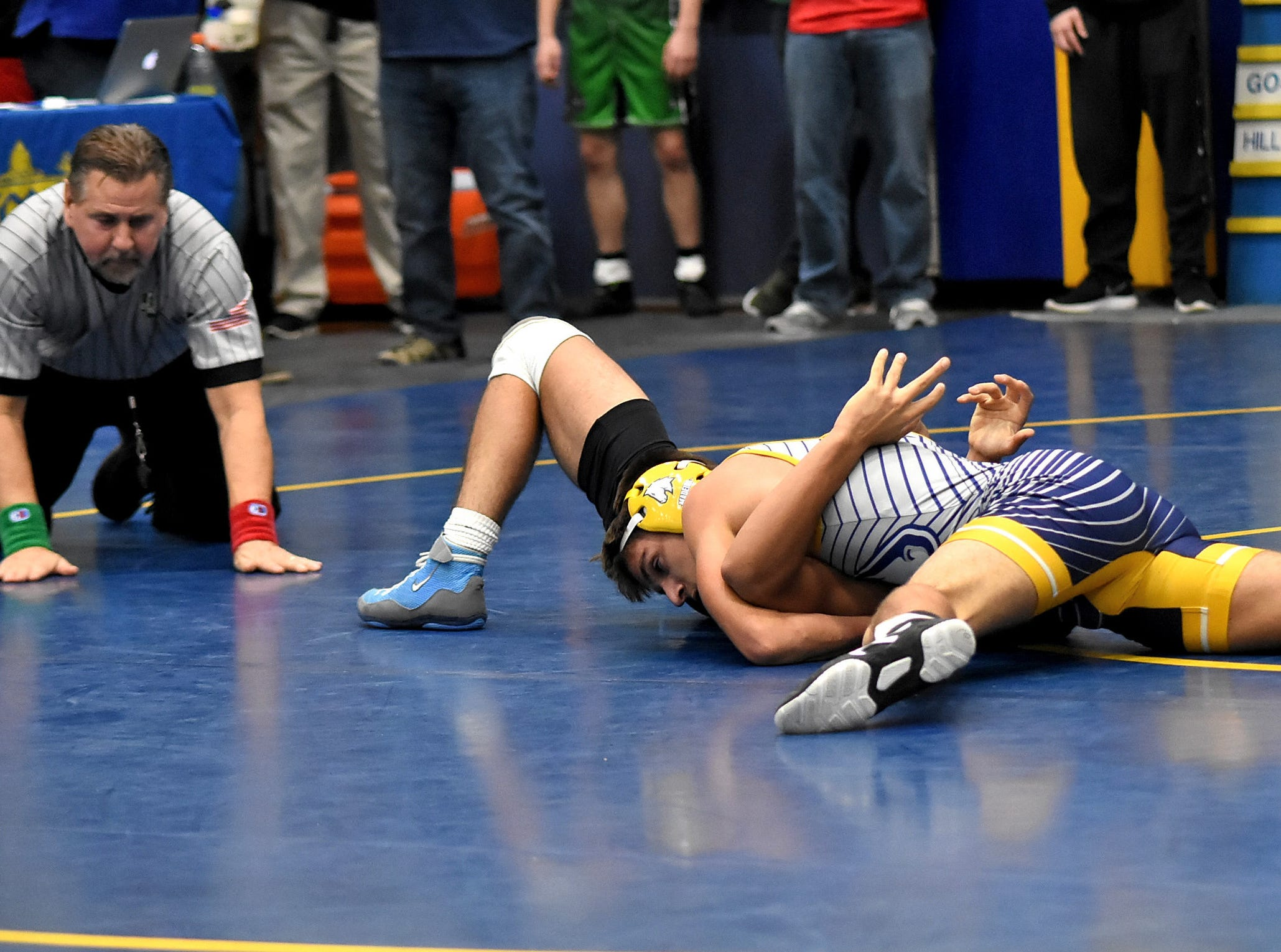 Madeira's Curtis Flores scores a first-round pinfall in the 138 lbs. class at the Bob Kearns Madeira Invitational, January 4, 2019.