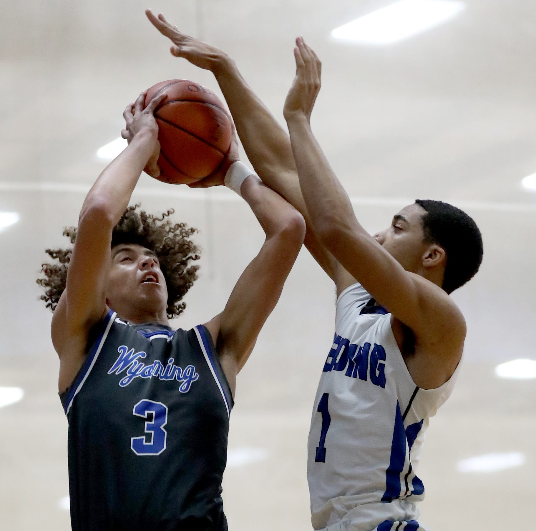 Wyoming guard Evan Prater (3) shoots the ball over Reading guard A.J. Brown  during their basketball game , Friday, Jan.4, 2019.