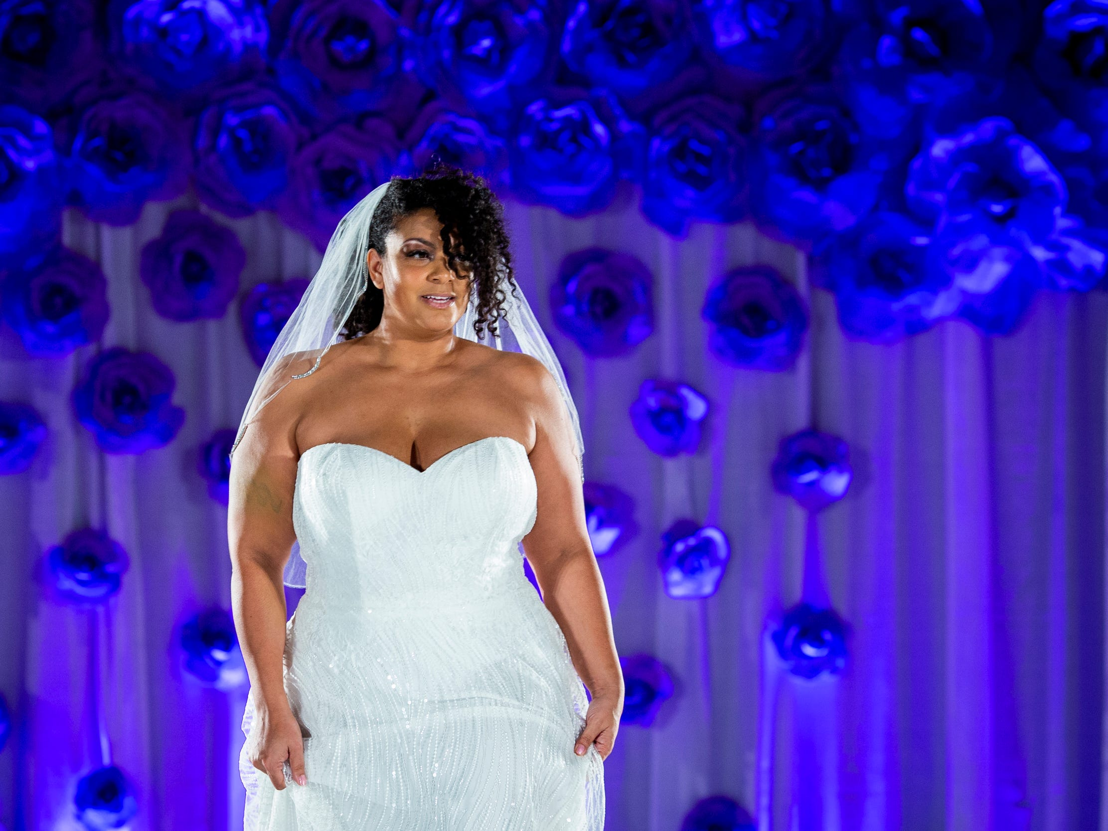 A model walks down the runway in a wedding dress for the fashion show at the Wendy's Bridal Show at the Duke Energy Convention Center Saturday, January 5, 2019 in Downtown Cincinnati.