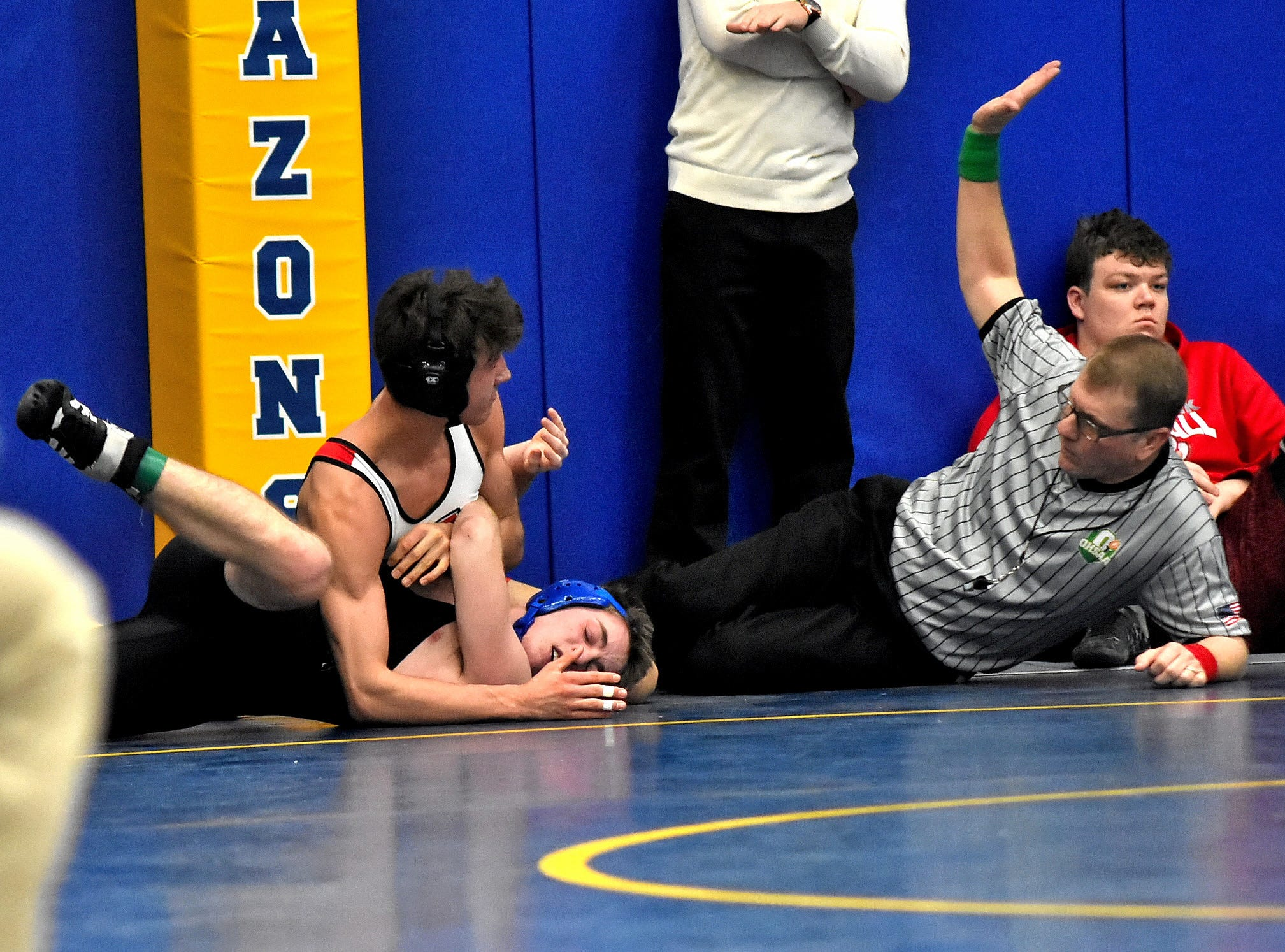 Jaden Anderson of Indian Hill looks at the referee as he signals a pin in his 145 lbs. class win over Jack Stewart of Summit Country Day at the Bob Kearns Madeira Invitational, January 4, 2019.
