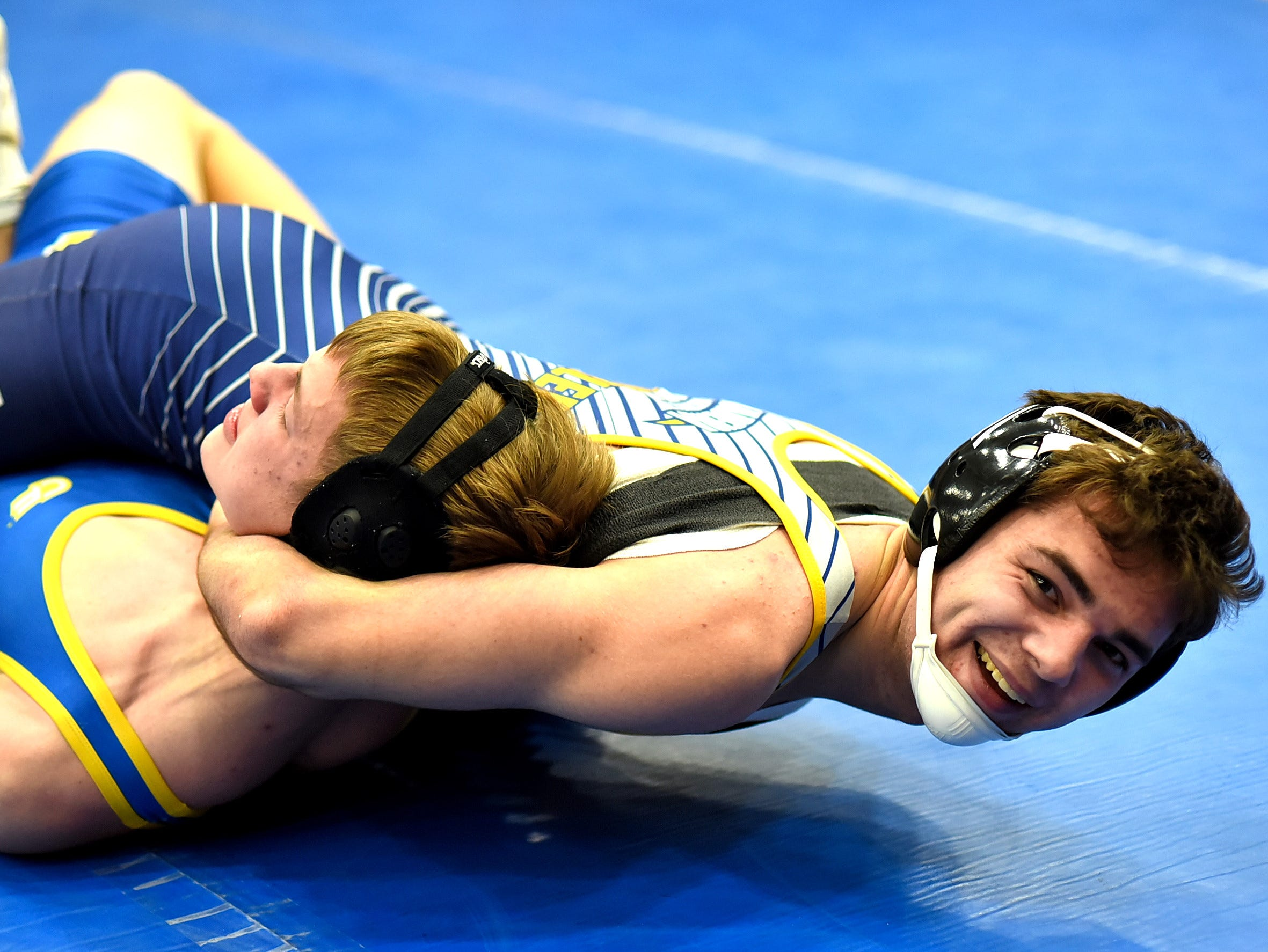Jackson Hugentobler of Madeira is all smiles as he pins Clermont Northeastern's Jacob Groeber at the Bob Kearns Madeira Invitational, January 4, 2019.