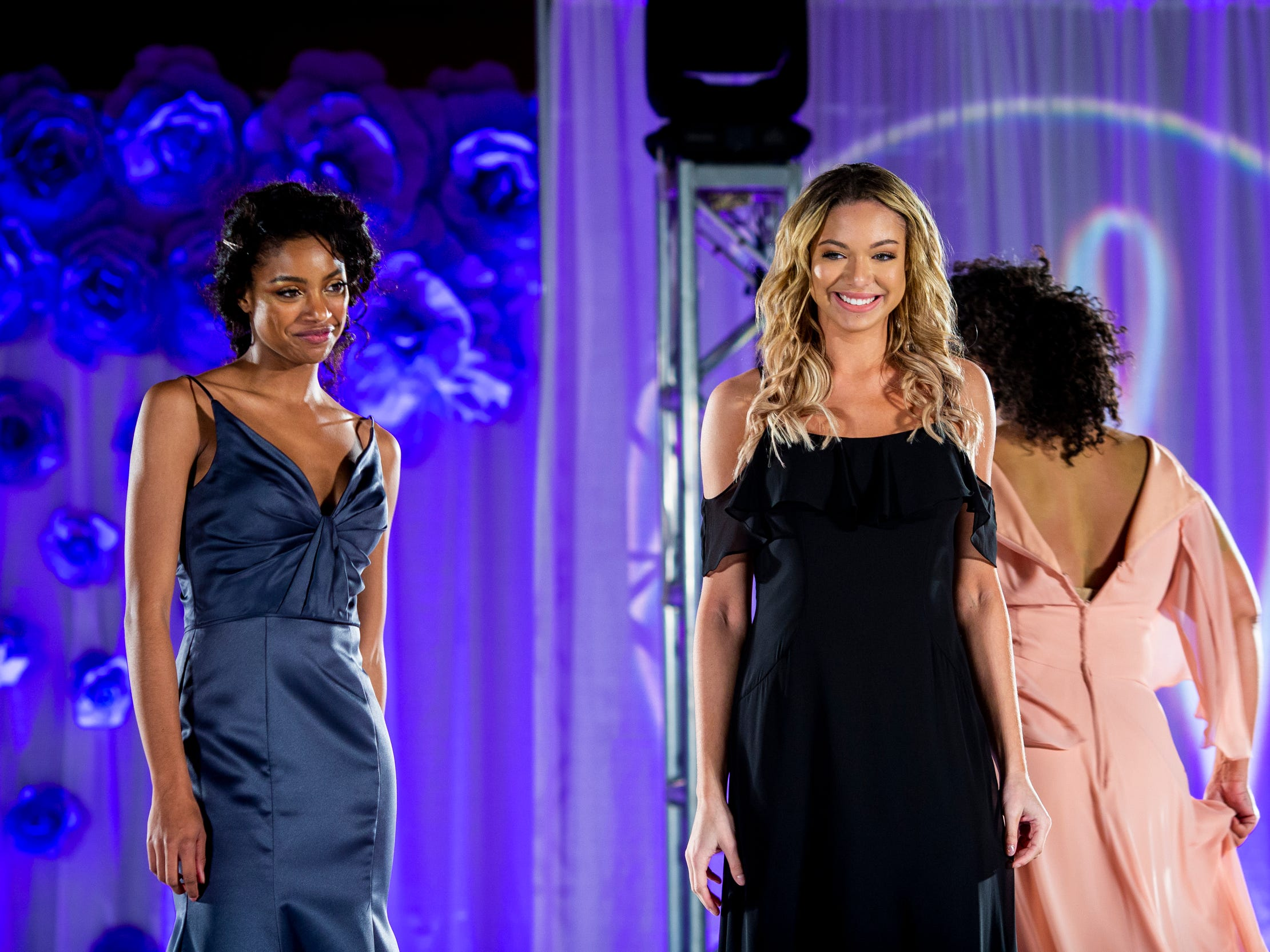Models wear the latest styles of bridesmaid dresses for the fashion show at the Wendy's Bridal Show at the Duke Energy Convention Center Saturday, January 5, 2019 in Downtown Cincinnati.
