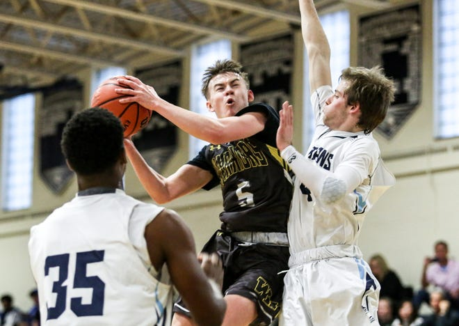Watchung Hills' Lucas Stasil (5) goes to the basket as Immaculata defends  during the first half on Saturday, Jan. 5, 2018 at Immaculata High School.
