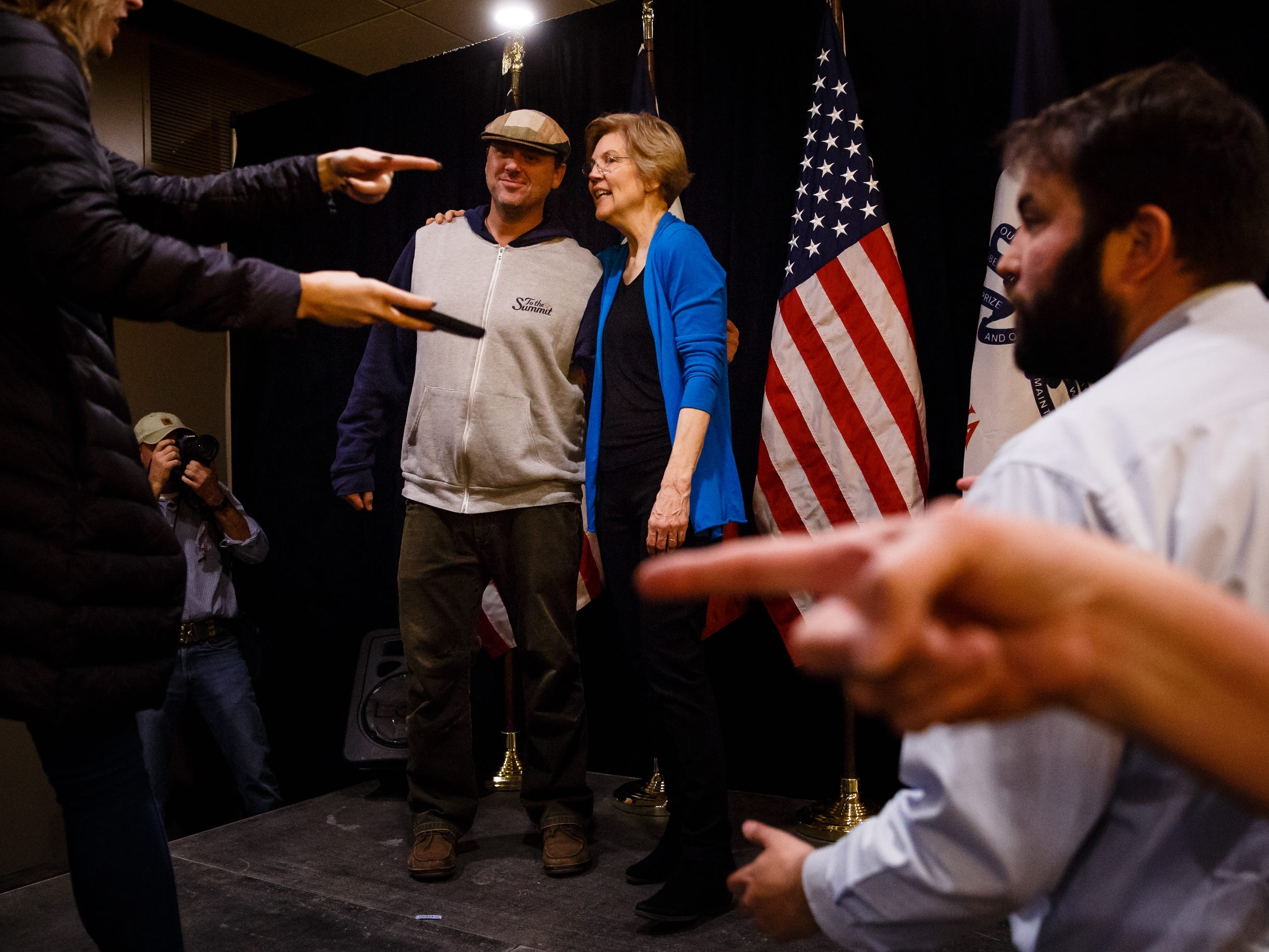 Sen. Elizabeth Warren takes photos with people after speaking at an event on her first trip through Iowa as a possible 2020 presidential candidate on Friday, Jan. 4, 2019, in Council Bluffs.