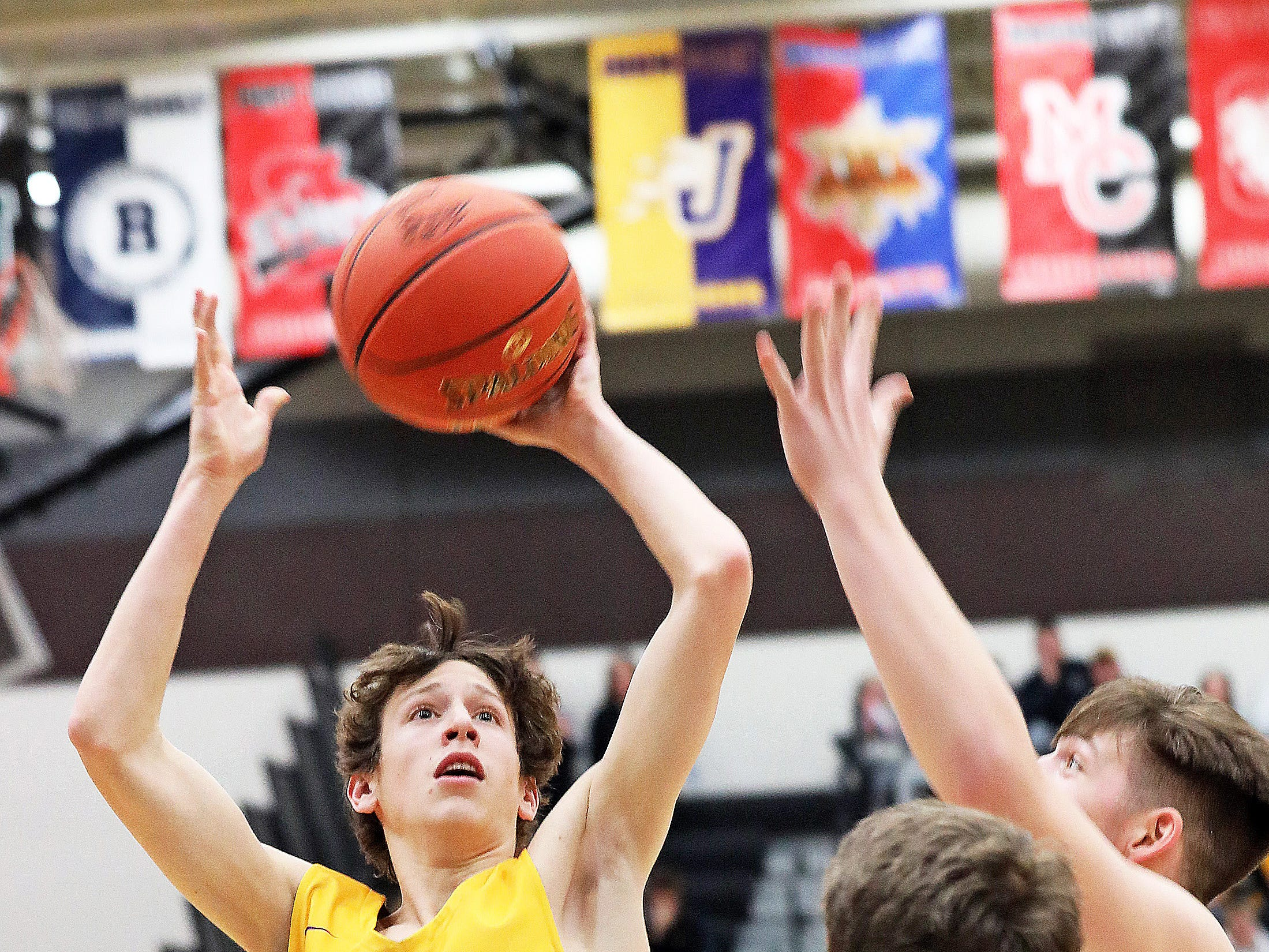 Johnston junior Garrett Miller sinks the running lay-up as the Johnston Dragons compete against the Ankeny Centennial Jaguars in high school boys basketball on Friday, Jan. 4, 2019 at Ankeny Centennial High School.  Ankeny won 53 to 46.
