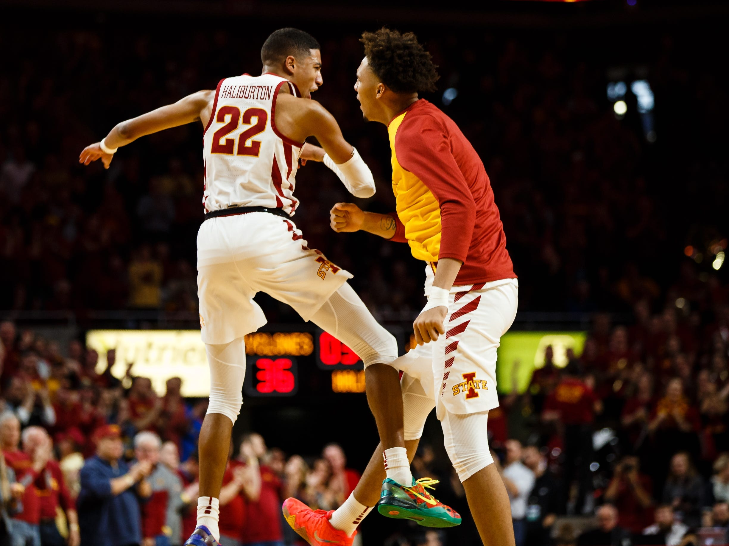 Iowa State's Tyrese Haliburton (22) celebrates with Iowa State's George Conditt IV (4) after a big 3-pointer during the first half of their basketball game on Saturday, Jan. 5, 2019, in Ames.