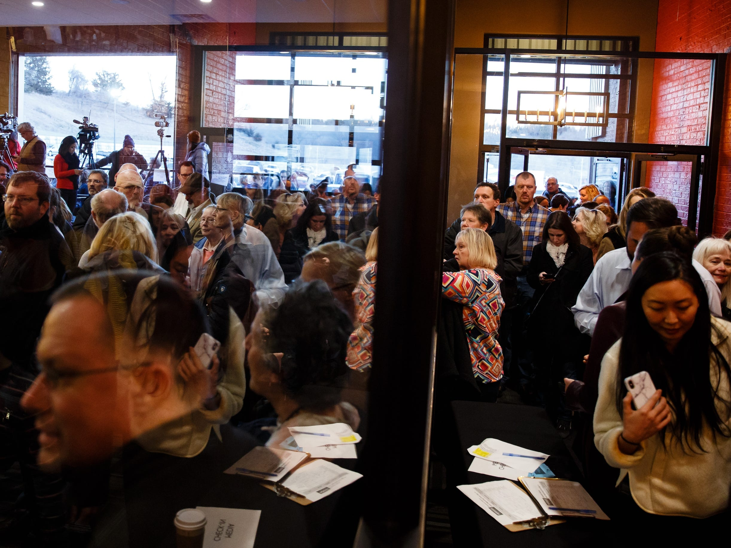 Spectators crowd the room before Sen. Elizabeth Warren speaks during an event on her first trip through Iowa as a possible 2020 presidential candidate on Friday, Jan. 4, 2019, in Council Bluffs.