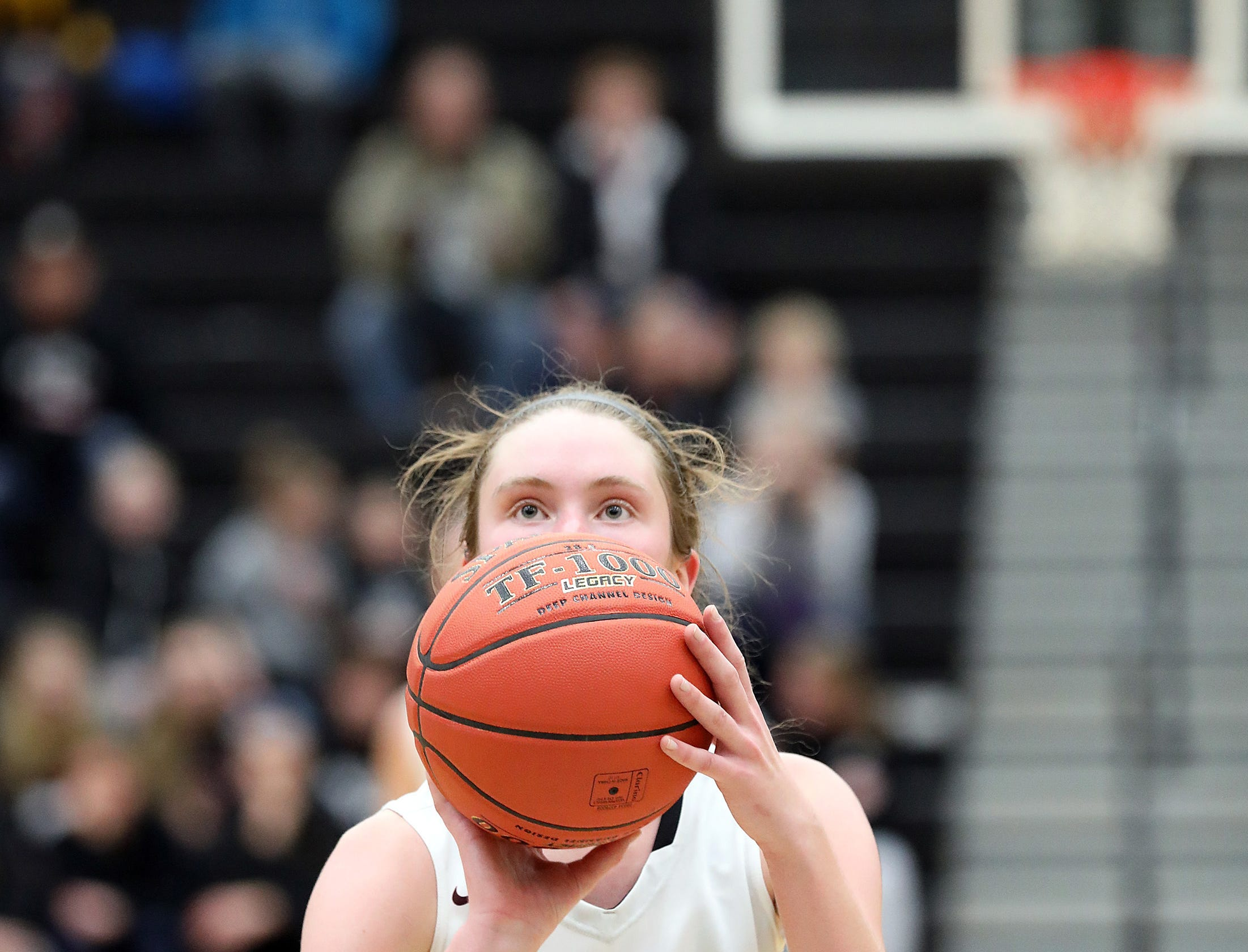 Ankeny Centennial junior Meg Burns sinks the final two free throws for the victory as the Johnston Dragons compete against the Ankeny Centennial Jaguars in high school girls basketball on Friday, Jan. 4, 2019 at Ankeny Centennial High School. Ankeny won 50 to 48.