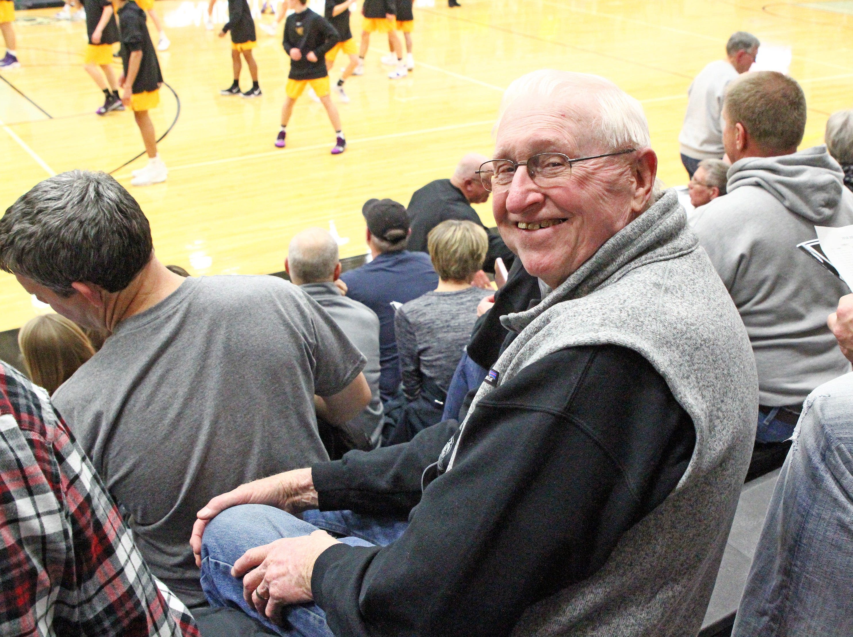 Hall of Fame member and former Ankeny girls head coach Dick Rasmussen, three State Championship teams with 6-on-6, enjoys Friday Night hoops as the Johnston Dragons compete against the Ankeny Centennial Jaguars in high school girls basketball on Friday, Jan. 4, 2019 at Ankeny Centennial High School.