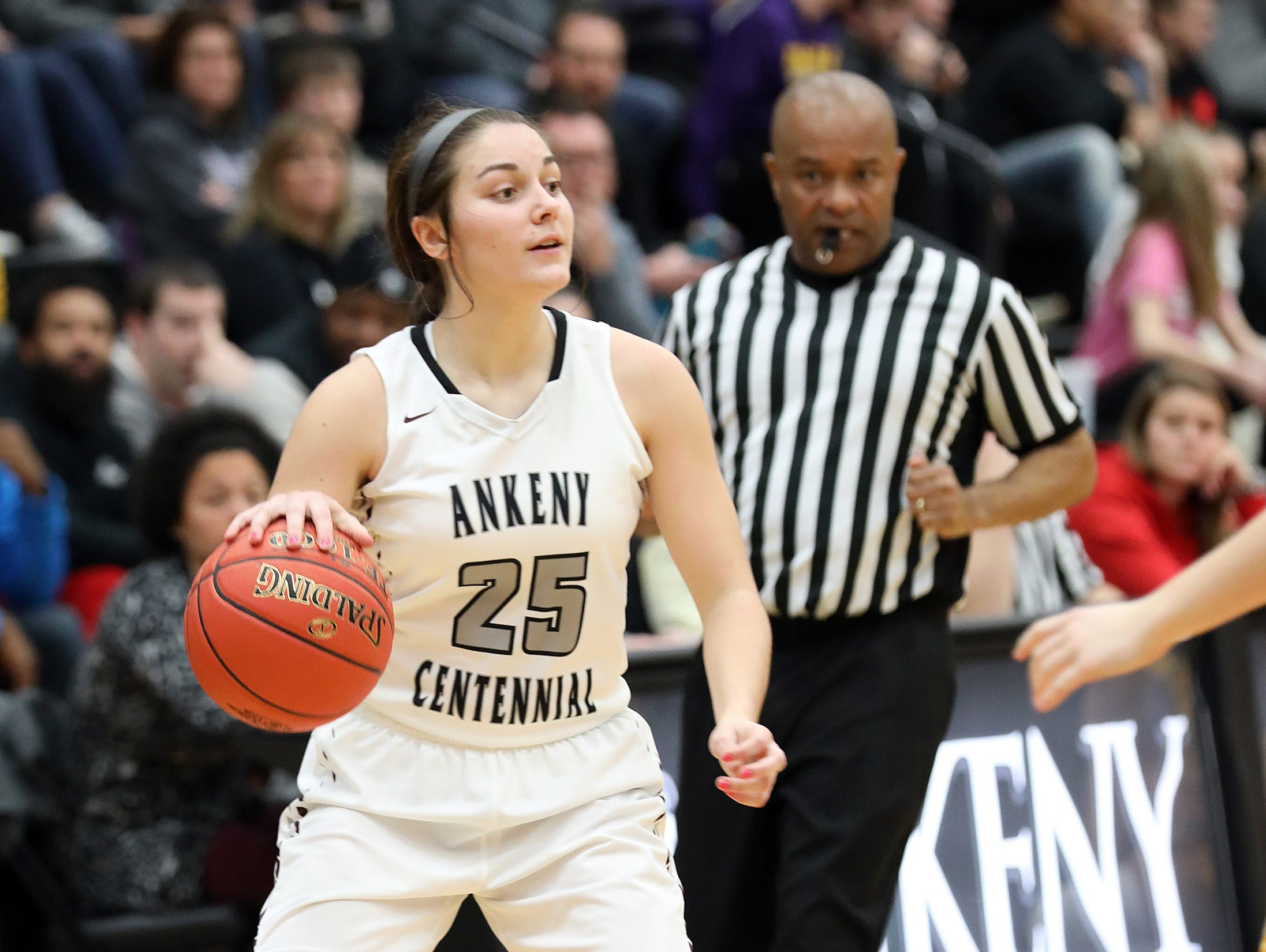 Ankeny Centennial freshman Cleao Murray looks to pass as the Johnston Dragons compete against the Ankeny Centennial Jaguars in high school girls basketball on Friday, Jan. 4, 2019 at Ankeny Centennial High School.