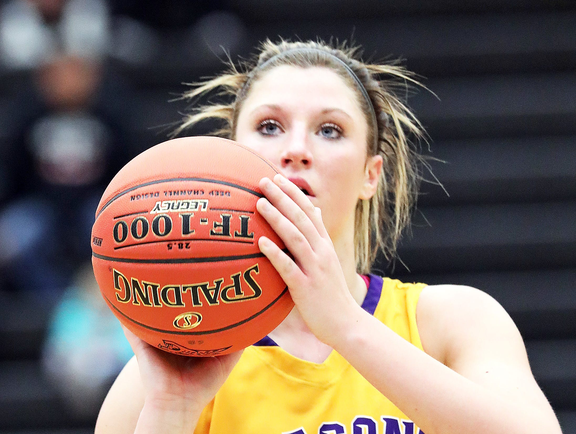 Johnston junior Maddie Mock eyes another free throw as the Johnston Dragons compete against the Ankeny Centennial Jaguars in high school girls basketball on Friday, Jan. 4, 2019 at Ankeny Centennial High School.