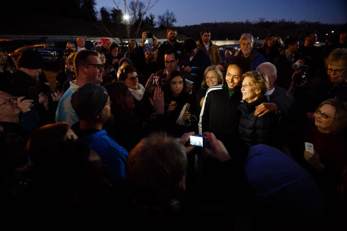 Elizabeth Warren poses for photos with an overflow crowd during an event on her first trip through Iowa as a possible 2020 presidential candidate on Friday, Jan. 4, 2019, in Council Bluffs.