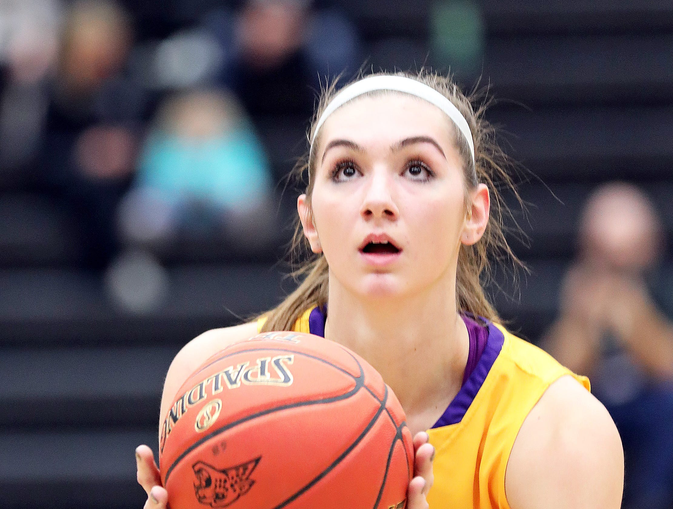 Johnston senior Regan Nesheim sinks the free throw as the Johnston Dragons compete against the Ankeny Centennial Jaguars in high school girls basketball on Friday, Jan. 4, 2019 at Ankeny Centennial High School.