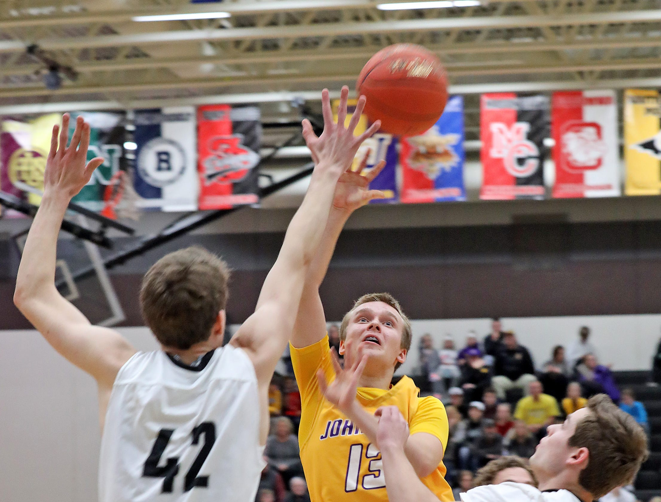 Johnston freshman Jacob Runyan drives the lane as the Johnston Dragons compete against the Ankeny Centennial Jaguars in high school boys basketball on Friday, Jan. 4, 2019 at Ankeny Centennial High School.  Centennial won 53 to 46.