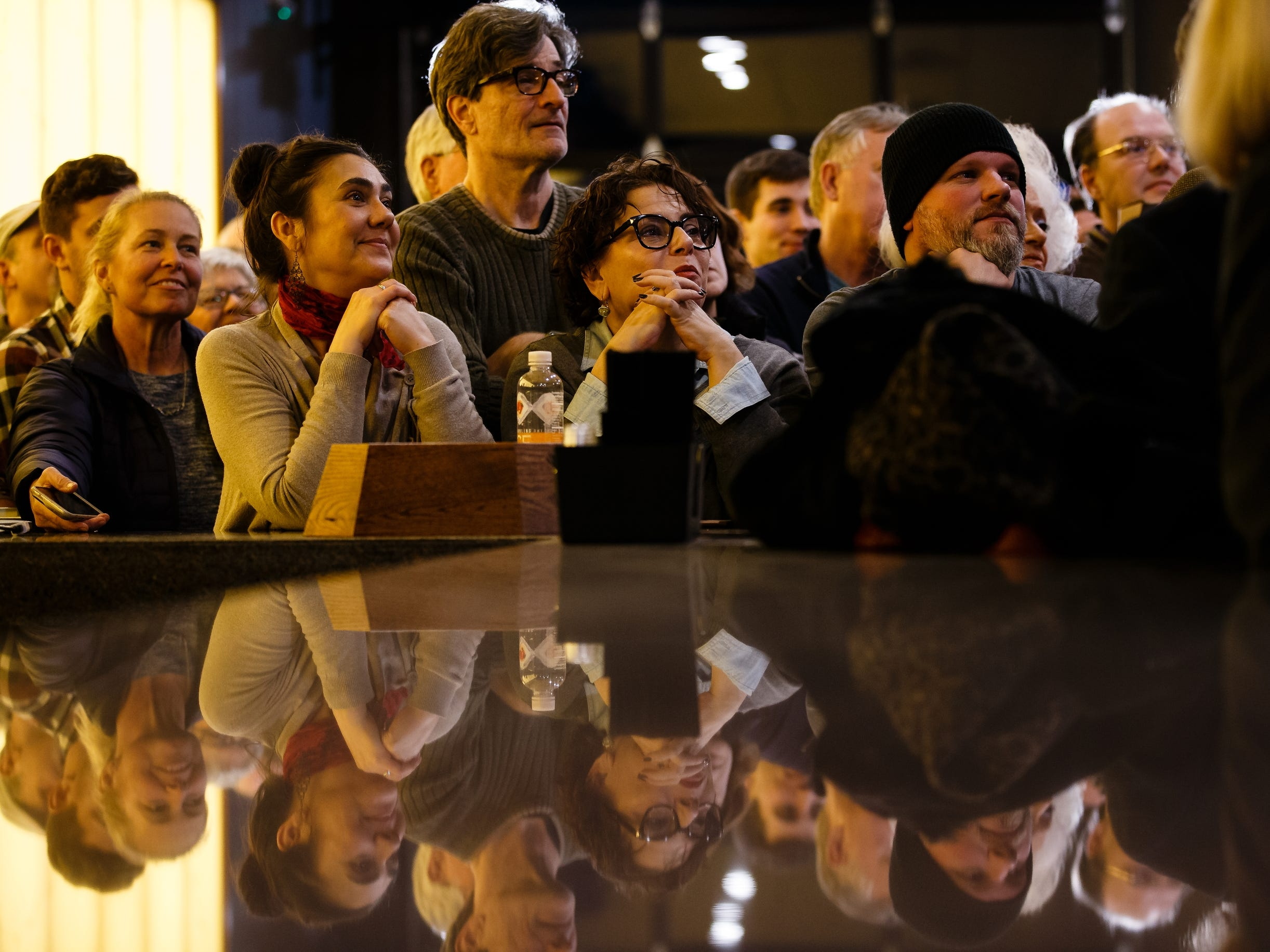 Spectators watch as Sen. Elizabeth Warren speaks during an event on her first trip through Iowa as a possible 2020 presidential candidate on Friday, Jan. 4, 2019, in Council Bluffs.