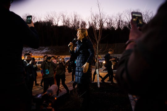 Sen. Elizabeth Warren speaks to the overflow crowd during an event on her first trip through Iowa as a possible 2020 presidential candidate on Friday, Jan. 4, 2019, in Council Bluffs.