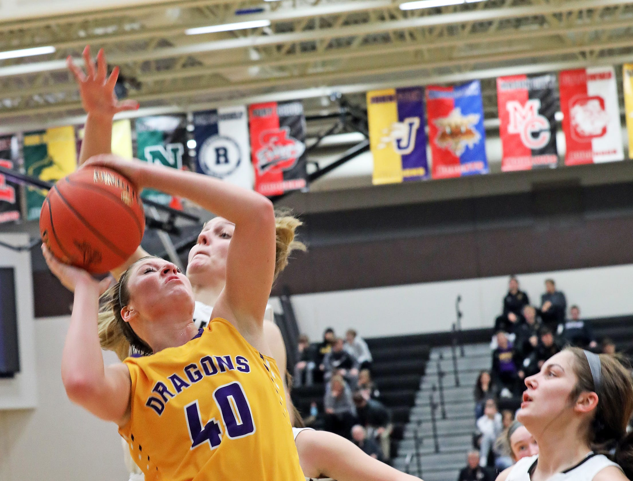Johnston junior Maddie Mock works hard for a shot as the Johnston Dragons compete against the Ankeny Centennial Jaguars in high school girls basketball on Friday, Jan. 4, 2019 at Ankeny Centennial High School.
