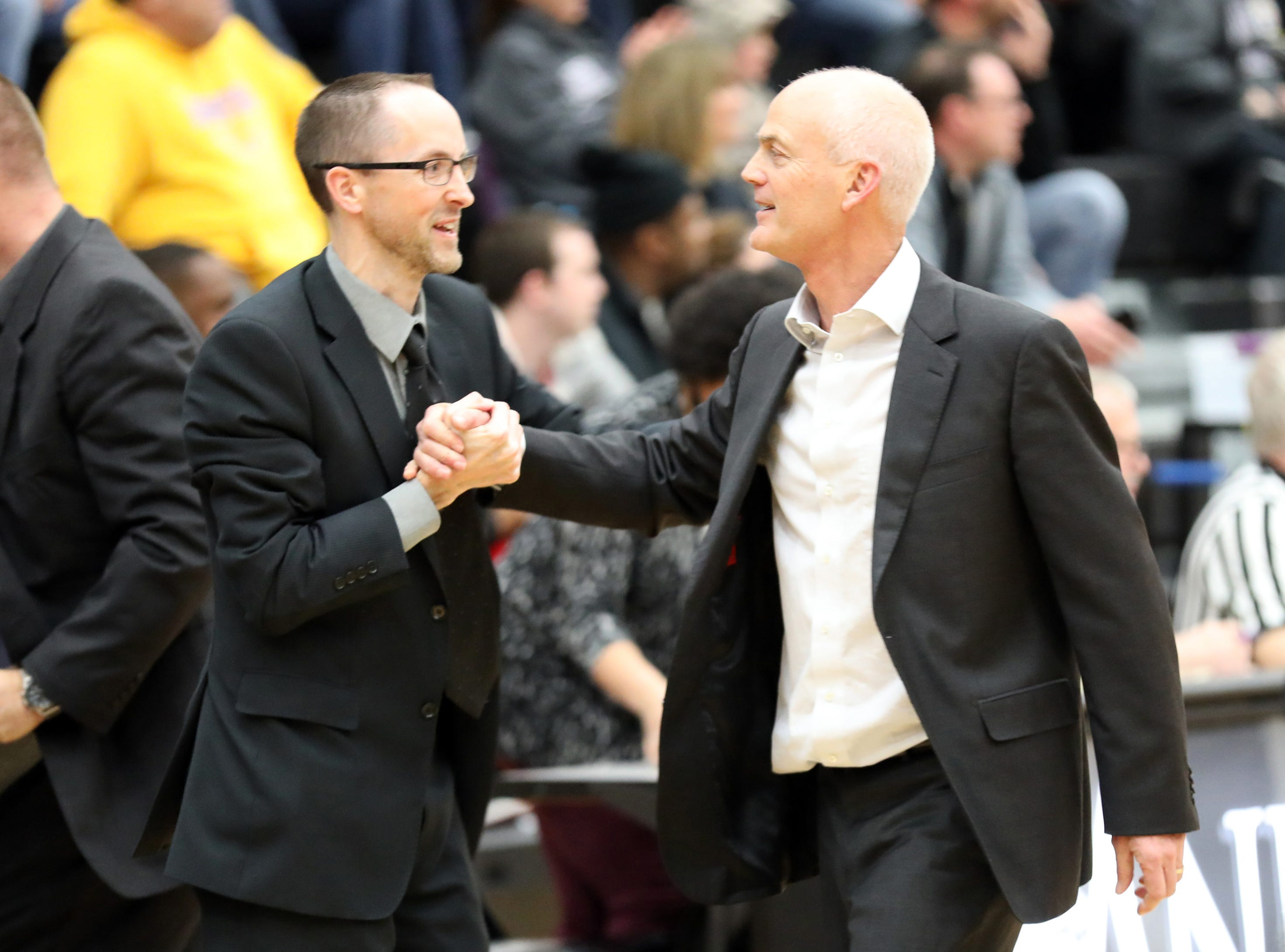 Ankeny Centennial head coach Scott DeJong is congratulated for the last second victory as the Johnston Dragons compete against the Ankeny Centennial Jaguars in high school girls basketball on Friday, Jan. 4, 2019 at Ankeny Centennial High School. Ankeny won 50 to 48.