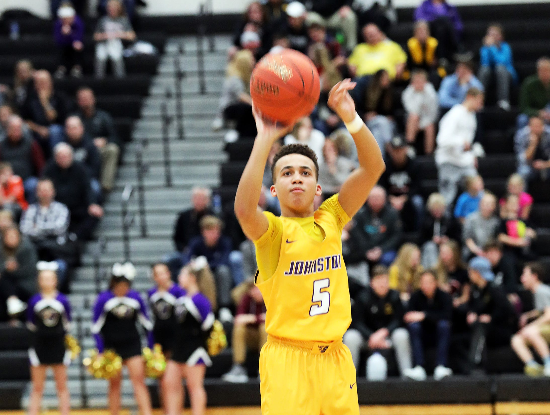 Johnston freshman and sharp-shooter Trey Lewis drains another three-pointer as the Johnston Dragons compete against the Ankeny Centennial Jaguars in high school boys basketball on Friday, Jan. 4, 2019 at Ankeny Centennial High School.  Centennial won 53 to 46.
