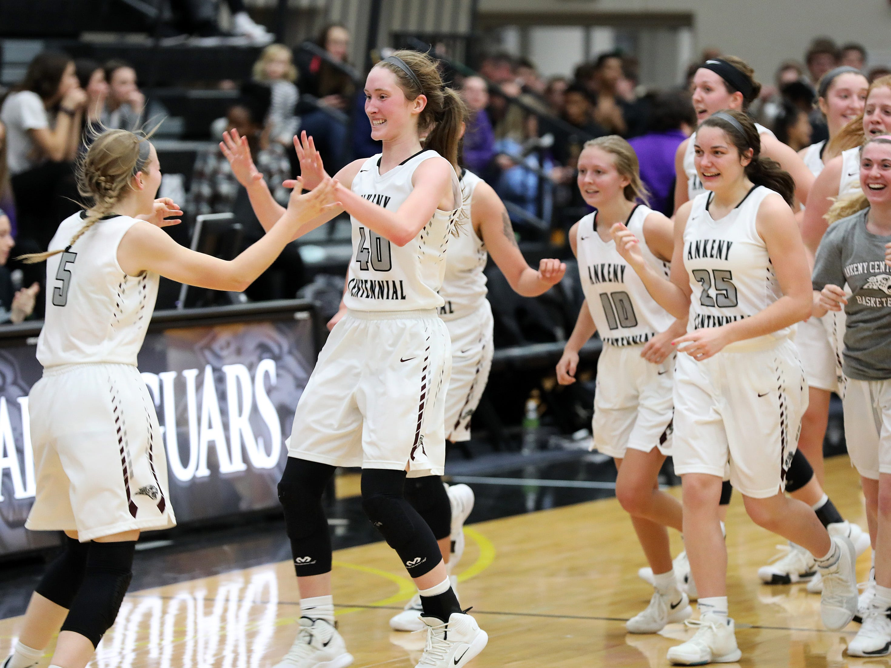 The Jags celebrate the close victory as the Johnston Dragons compete against the Ankeny Centennial Jaguars in high school girls basketball on Friday, Jan. 4, 2019 at Ankeny Centennial High School.