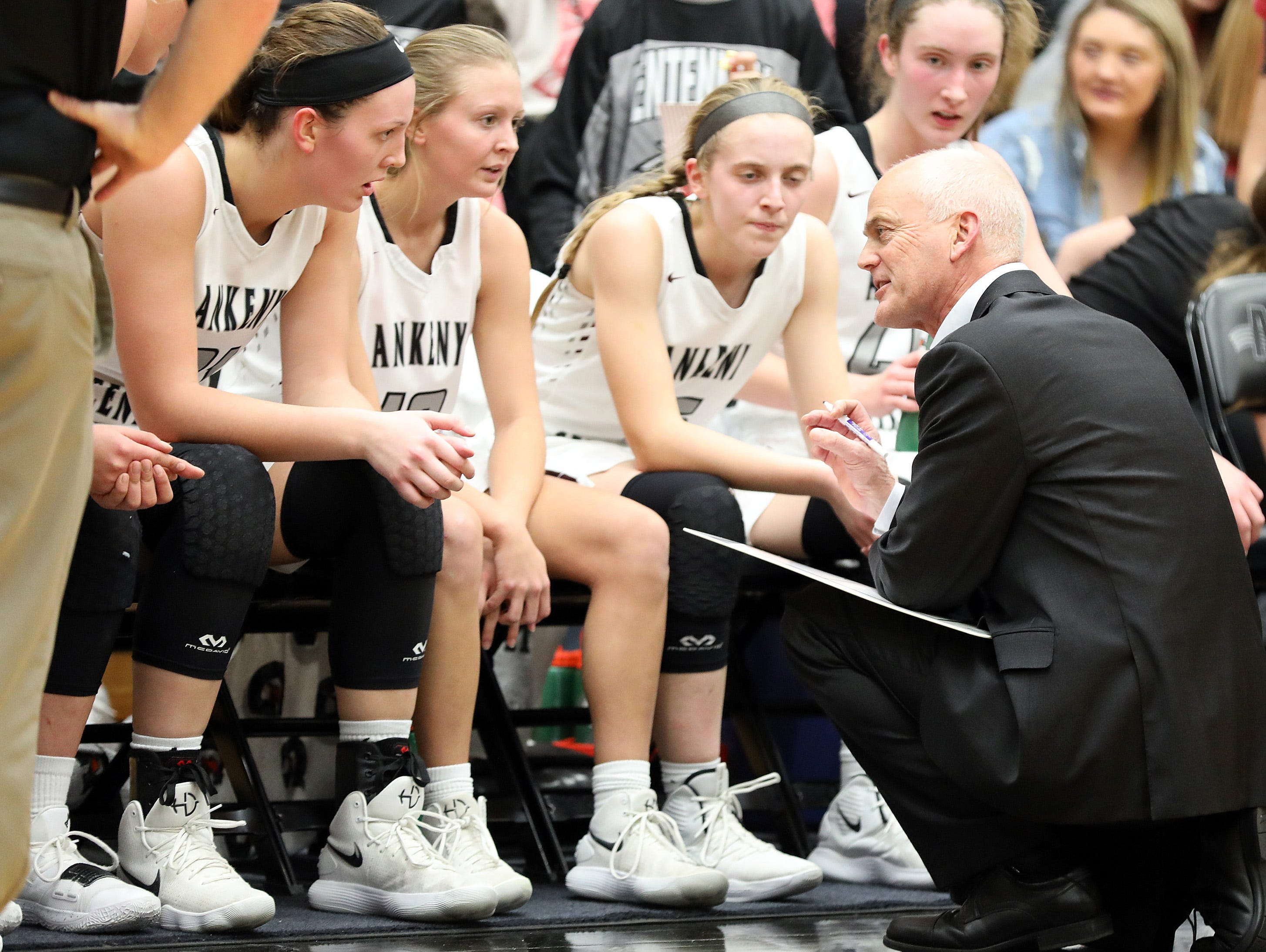 Ankeny Centennial head coach Scott DeJong provides a plan to win during a time-out as the Johnston Dragons compete against the Ankeny Centennial Jaguars in high school girls basketball on Friday, Jan. 4, 2019 at Ankeny Centennial High School.