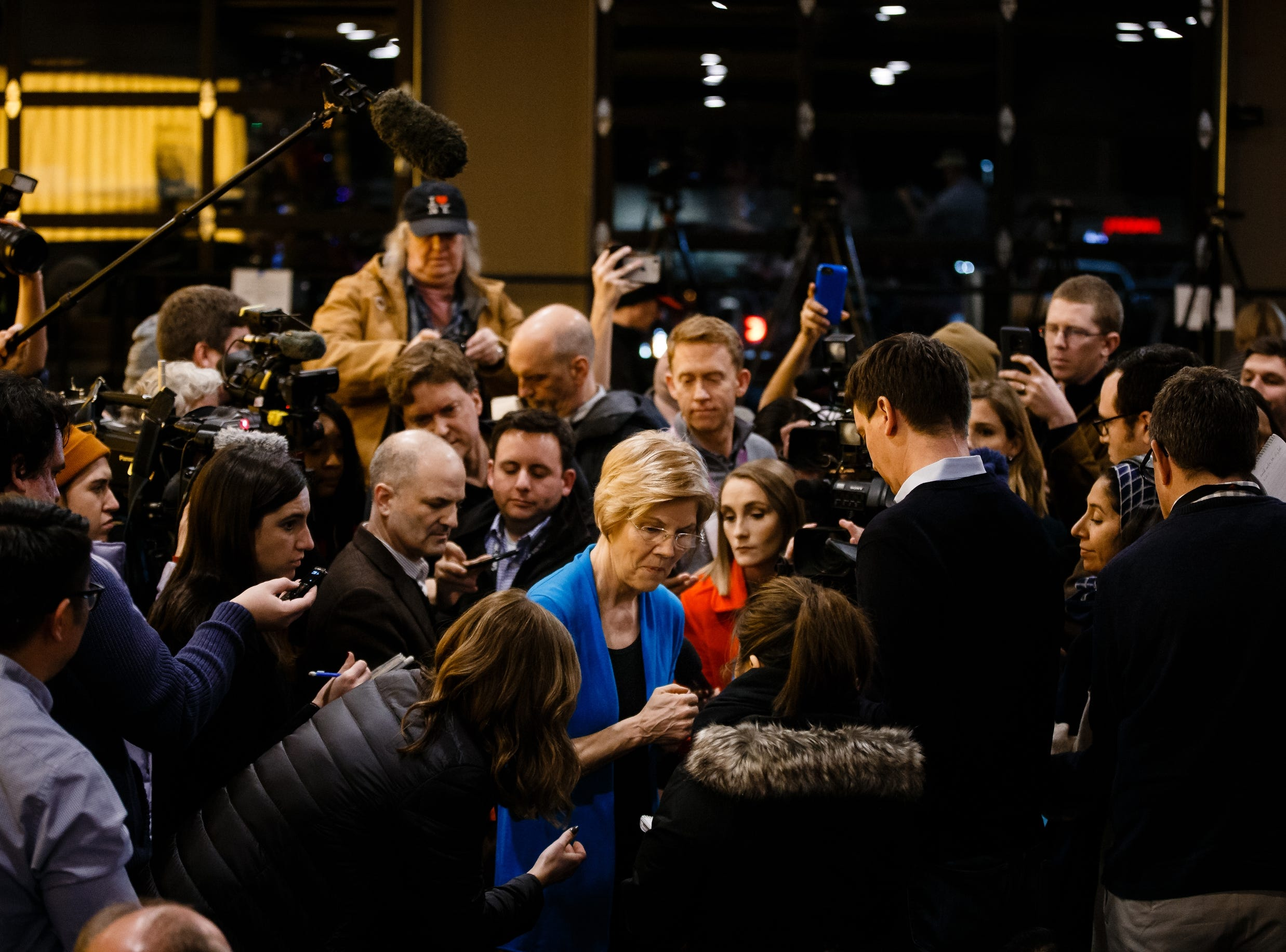 Sen. Elizabeth Warren speaks to members of the press pool during an event on her first trip through Iowa as a possible 2020 presidential candidate on Friday, Jan. 4, 2019, in Council Bluffs.