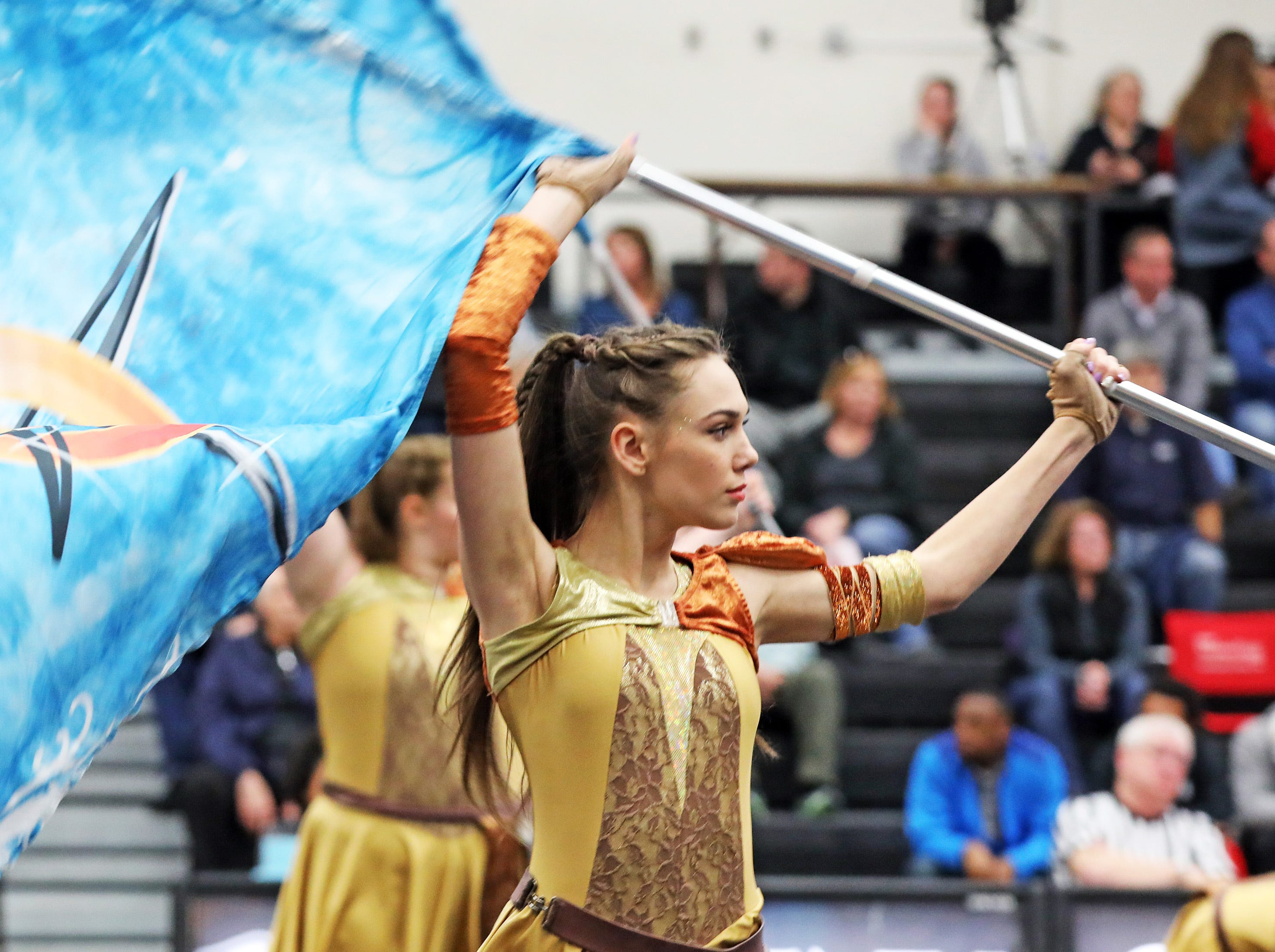 The ACHS Color Guard perform during half-time as the Johnston Dragons compete against the Ankeny Centennial Jaguars in high school girls basketball on Friday, Jan. 4, 2019 at Ankeny Centennial High School.