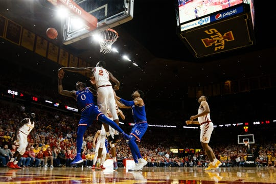 Iowa State's Cameron Lard (2) blocks the shot of Kansas' Marcus Garrett (0) during the first half of their basketball game on Saturday, Jan. 5, 2019, in Ames.