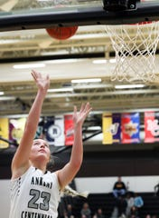 Ankeny Centennial senior Kenna Sauer sinks a lay-up in a Jan. 4 game against Johnston. Sauer averaged 17.5 points and eight rebounds in substate wins over Sioux City East and Pleasant Valley.