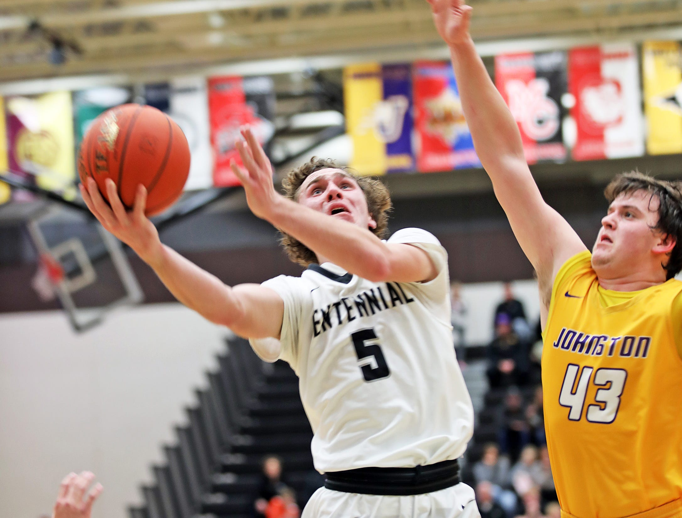 Ankeny Centennial junior Preston Kelling heads for a lay-up as the Johnston Dragons compete against the Ankeny Centennial Jaguars in high school boys basketball on Friday, Jan. 4, 2019 at Ankeny Centennial High School.
