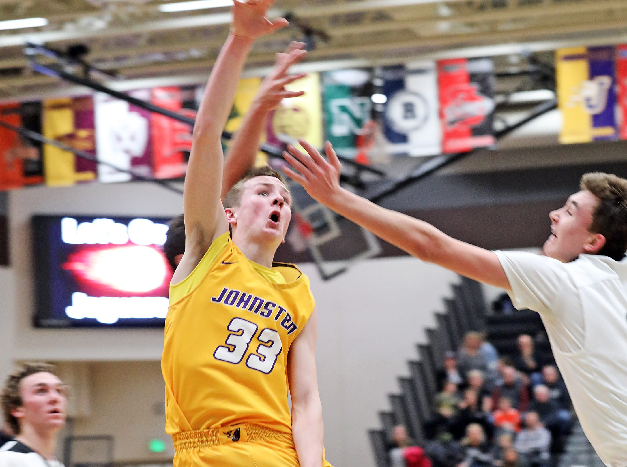 Johnston junior Lute Woodley shoots for two as the Johnston Dragons compete against the Ankeny Centennial Jaguars in high school boys basketball on Friday, Jan. 4, 2019 at Ankeny Centennial High School.  Centennial won 53 to 46.