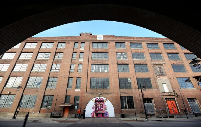 In this Dec. 19, 2018 photo, Dupaco Community Credit Unit is finalizing plans to spend about $37 million to redevelop the Voices Building on East 10th Street, an iconic building in the city's historic Millwork District.