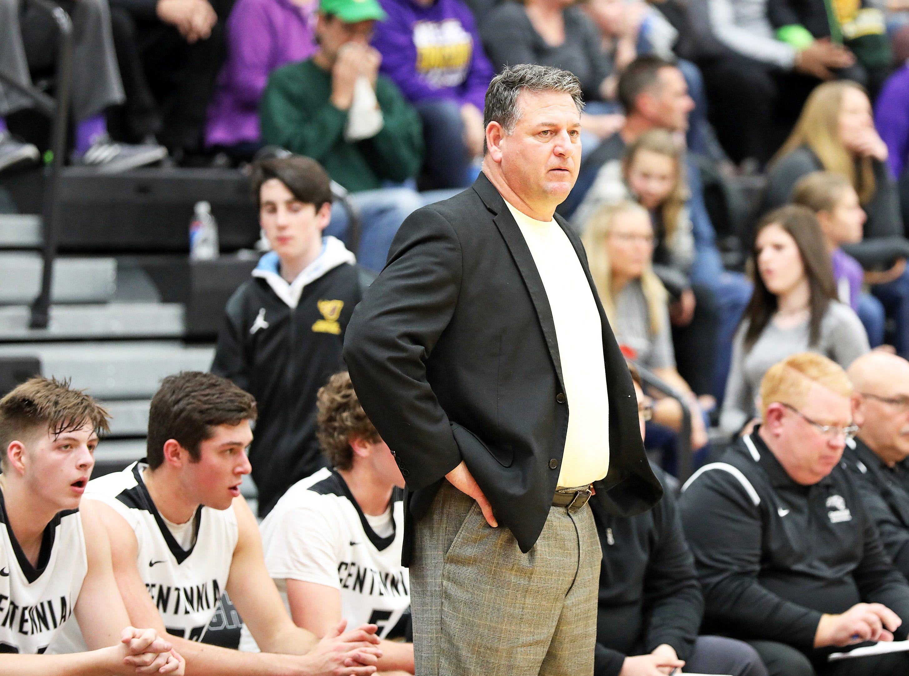 Ankeny Centennial head coach Bob Fontana watches his team execute a play as the Johnston Dragons compete against the Ankeny Centennial Jaguars in high school boys basketball on Friday, Jan. 4, 2019 at Ankeny Centennial High School.