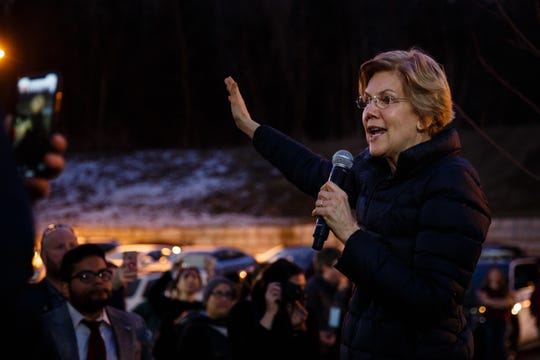 Sen. Elizabeth Warren speaks to the overflow crowdduring an event on her first trip through Iowa as a possible 2020 presidential candidate on Friday, Jan. 4, 2019, in Council Bluffs.