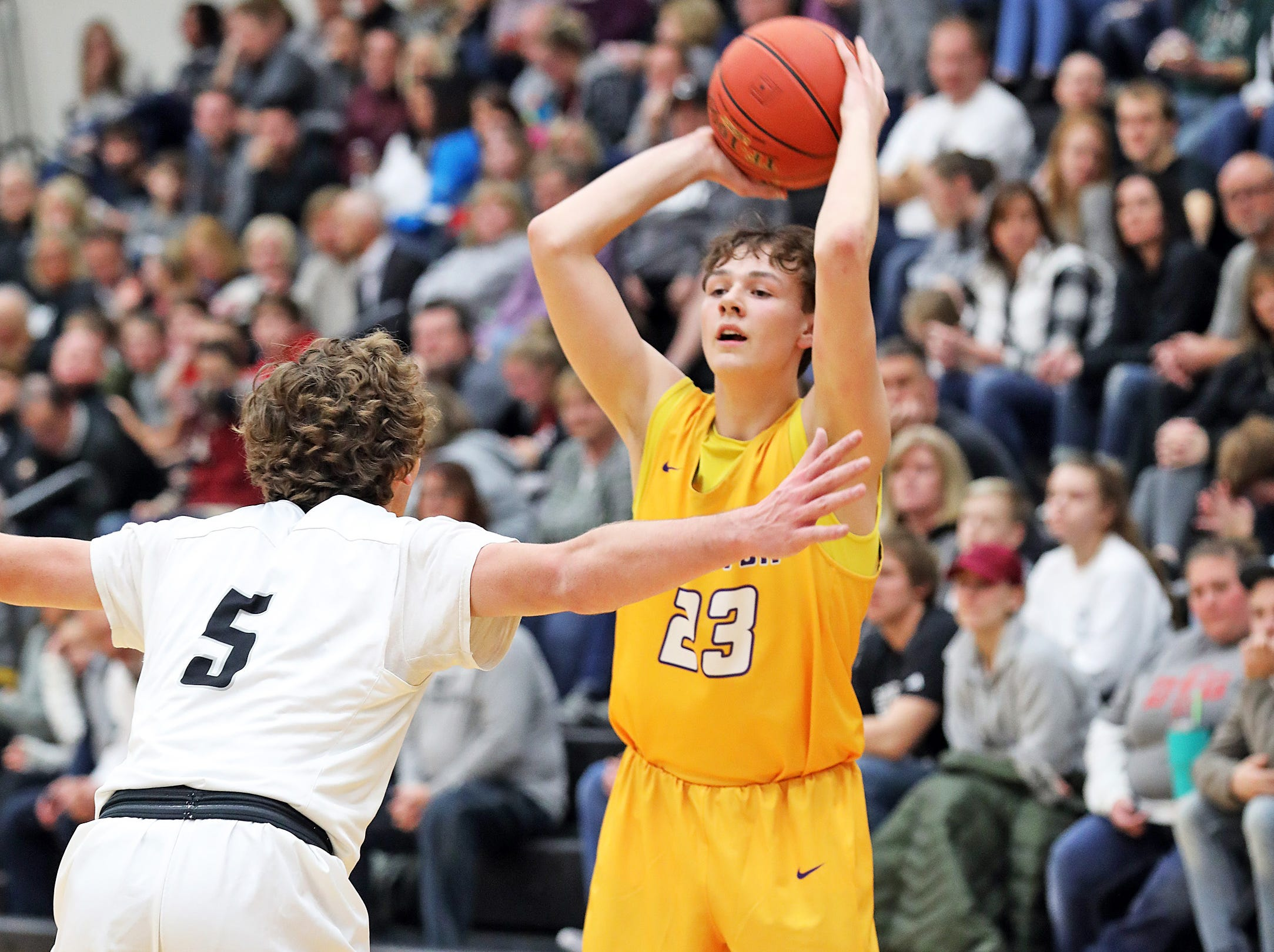 Johnston sophomore Reid Grant looks to pass as the Johnston Dragons compete against the Ankeny Centennial Jaguars in high school boys basketball on Friday, Jan. 4, 2019 at Ankeny Centennial High School.