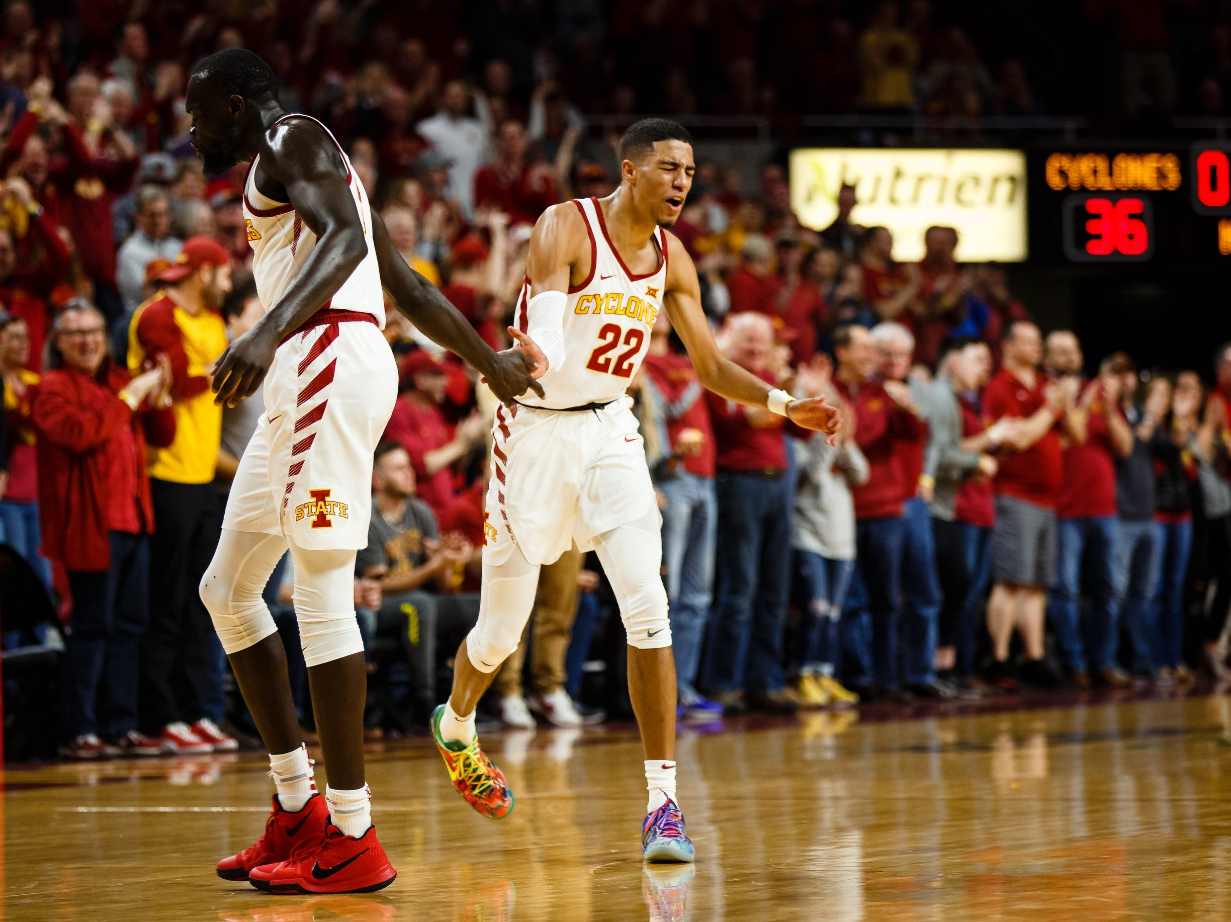 Iowa State's Tyrese Haliburton (22) and Iowa State's Marial Shayok (3) celebrate after a big three pointer during the first half of their basketball game on Saturday, Jan. 5, 2019, in Ames.