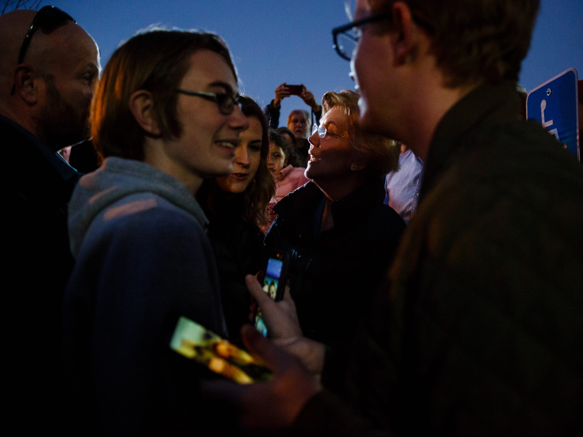 Sen. Elizabeth Warren mingles with the overflow crowd during an event on her first trip through Iowa as a possible 2020 presidential candidate on Friday, Jan. 4, 2019, in Council Bluffs.