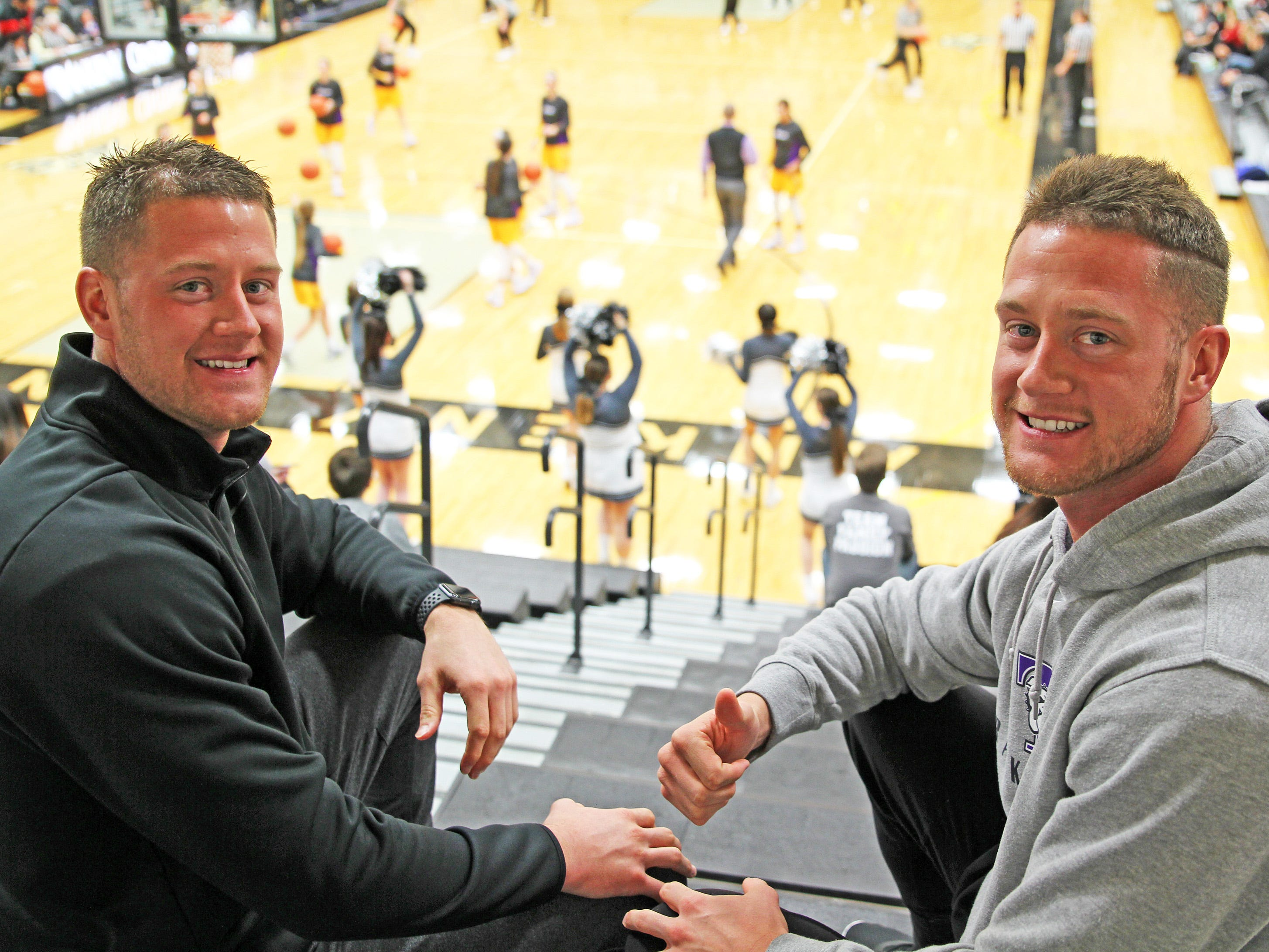 Former Ankeny basketball standouts Cole and Cory Myers, Class of 2012, enjoy Friday Night hoops as the Johnston Dragons compete against the Ankeny Centennial Jaguars in high school girls basketball on Friday, January 4, 2019 at Ankeny Centennial High School.